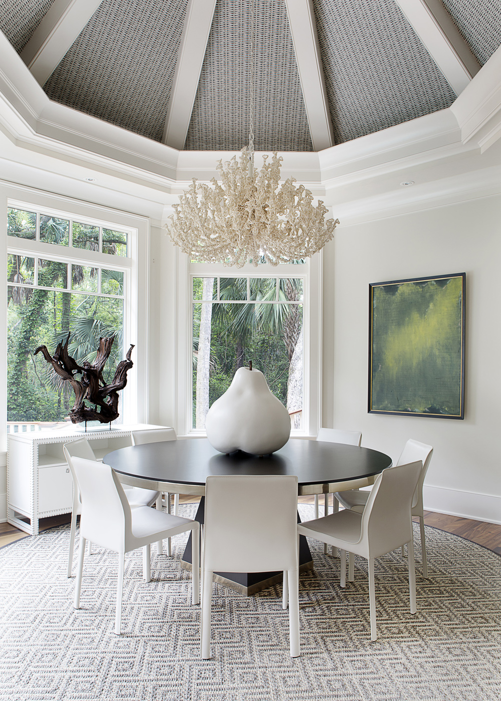 Dining room with round table and white DWR Bottega chairs; Palacek Seychelles Coco chandelier | Savage Interior Design