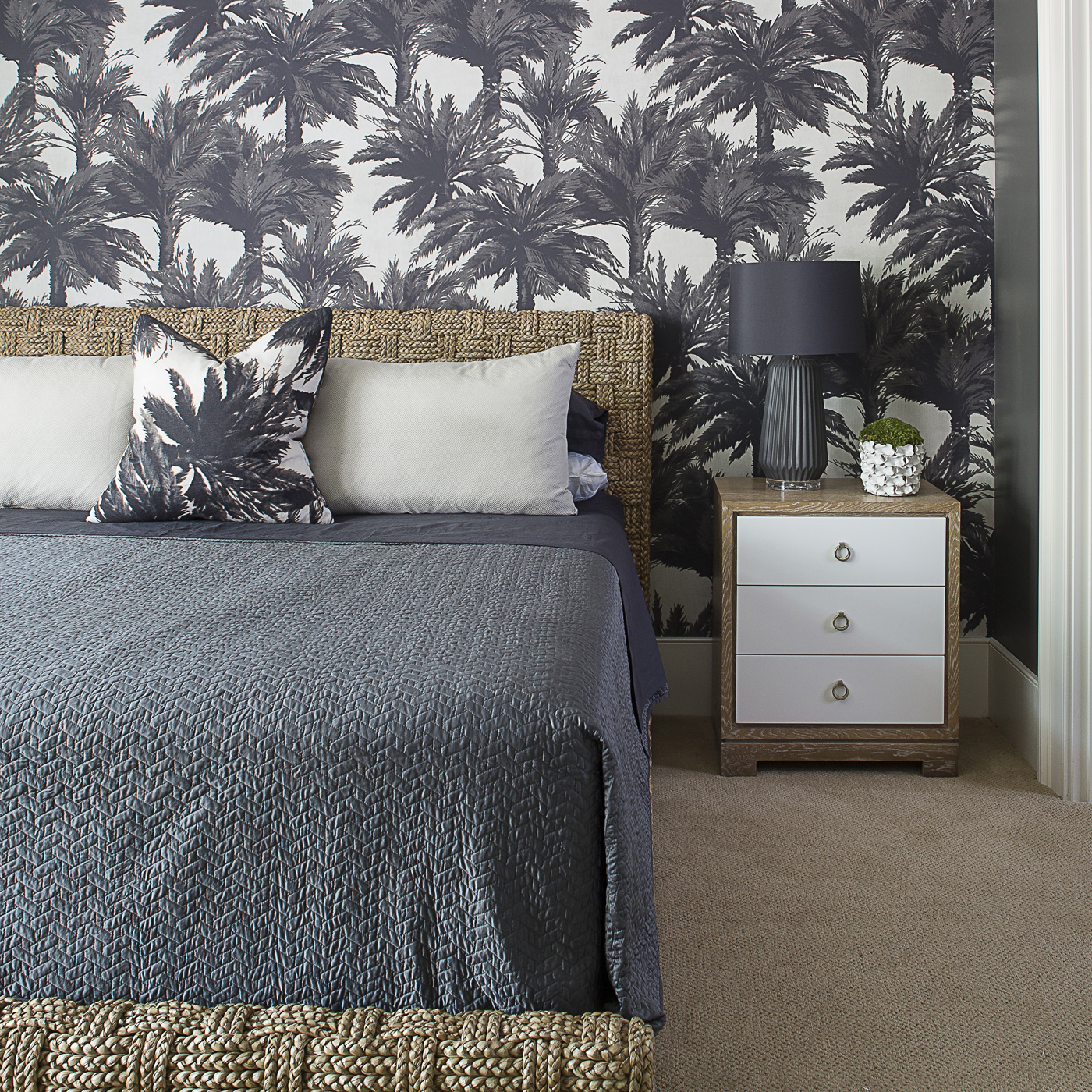 Pierre Frey palm tree fabric on wall and pillow; cerused table; natural woven bed; tropical island bedroom | Savage Interior Design