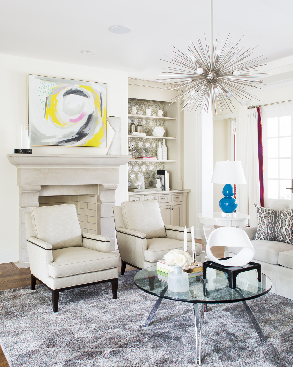 White and cream living room; red & turquoise accents; Roger Sprunger for Dunbar table; Kelly Wearstler chandelier | Savage Interior Design