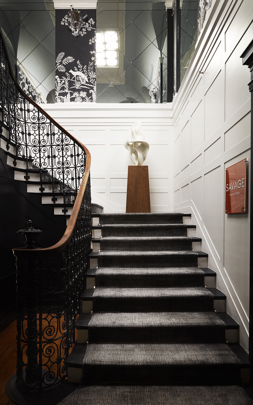 Staircase white paneled walls; Patterson Flynn & Martin runner; mirrored niche insets in harlequin pattern | Savage Interior Design