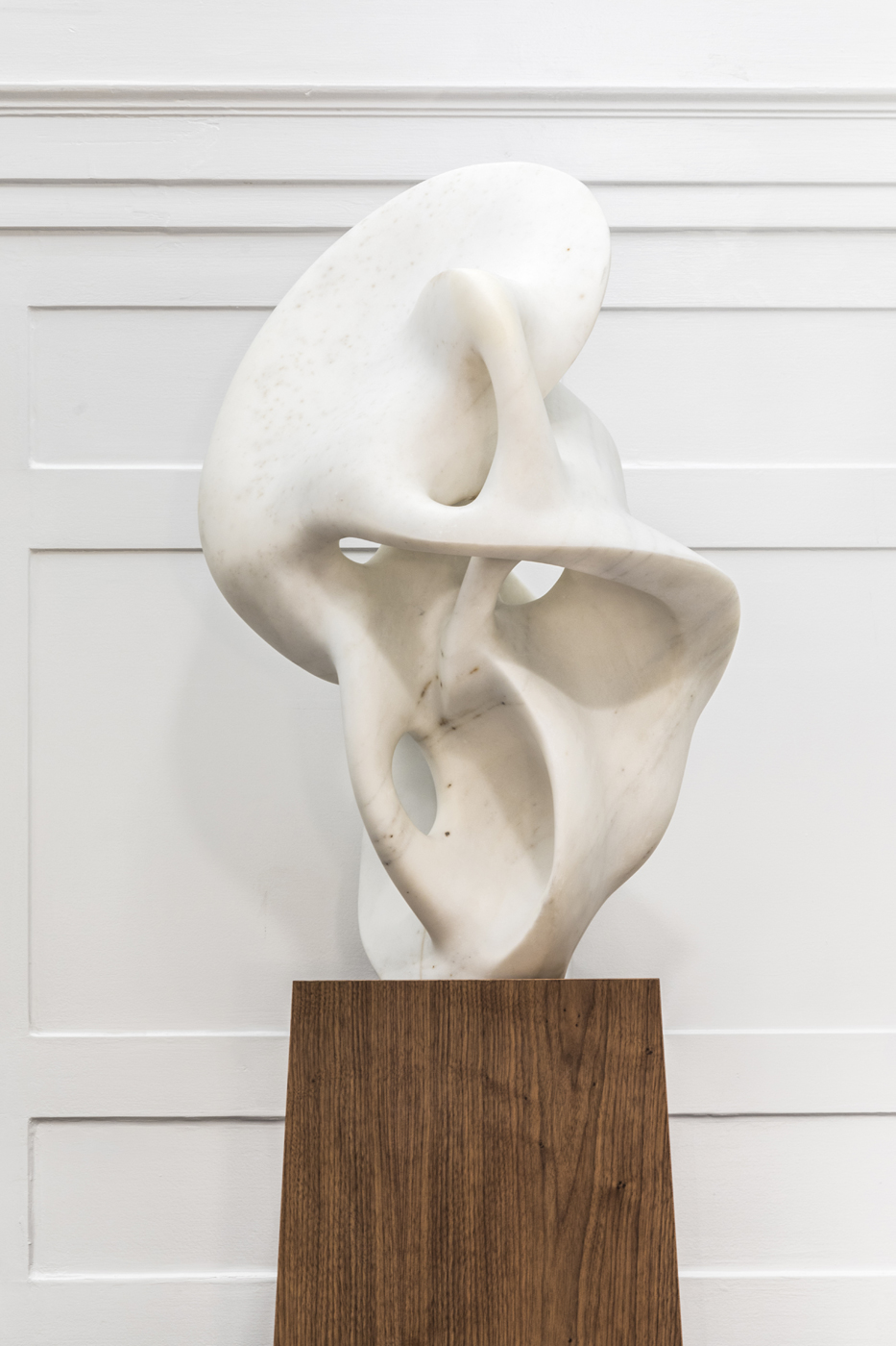 White marble abstract modern Saint Clair Cemin sculpture on tapered wooden pedestal | Savage Interior Design