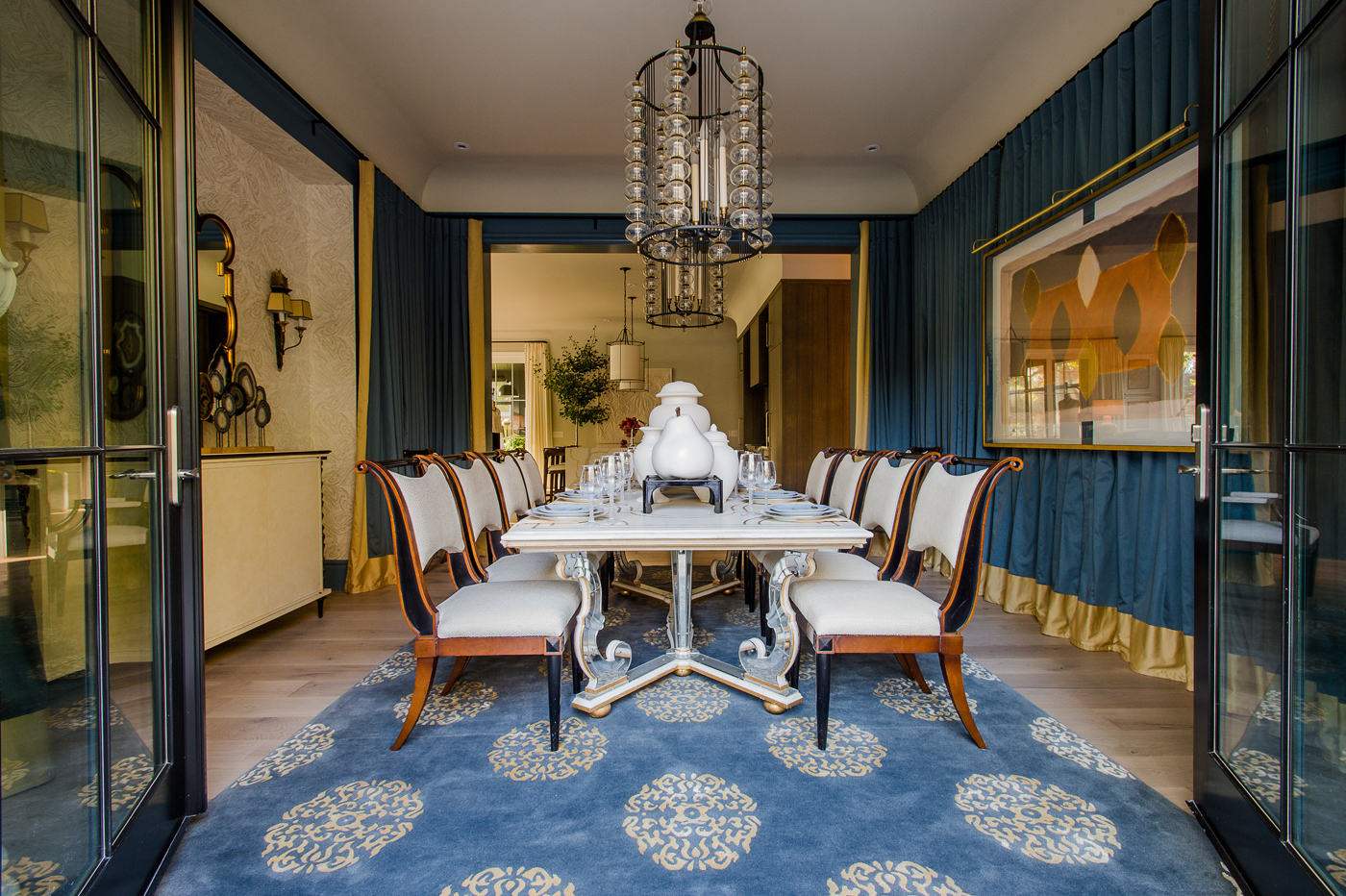 Maison Jansen-designed dining table with Biedermeier style chairs; Paul Ferrante pendant lights | Savage Interior Design
