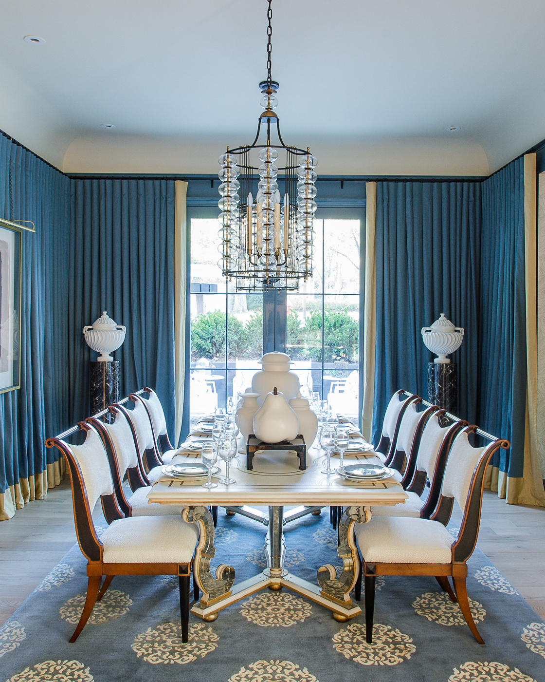 Blue drapery-lined dining room inspired by the White House Blue Room decorated by Maison Jansen in 1962 | Savage Interior Design
