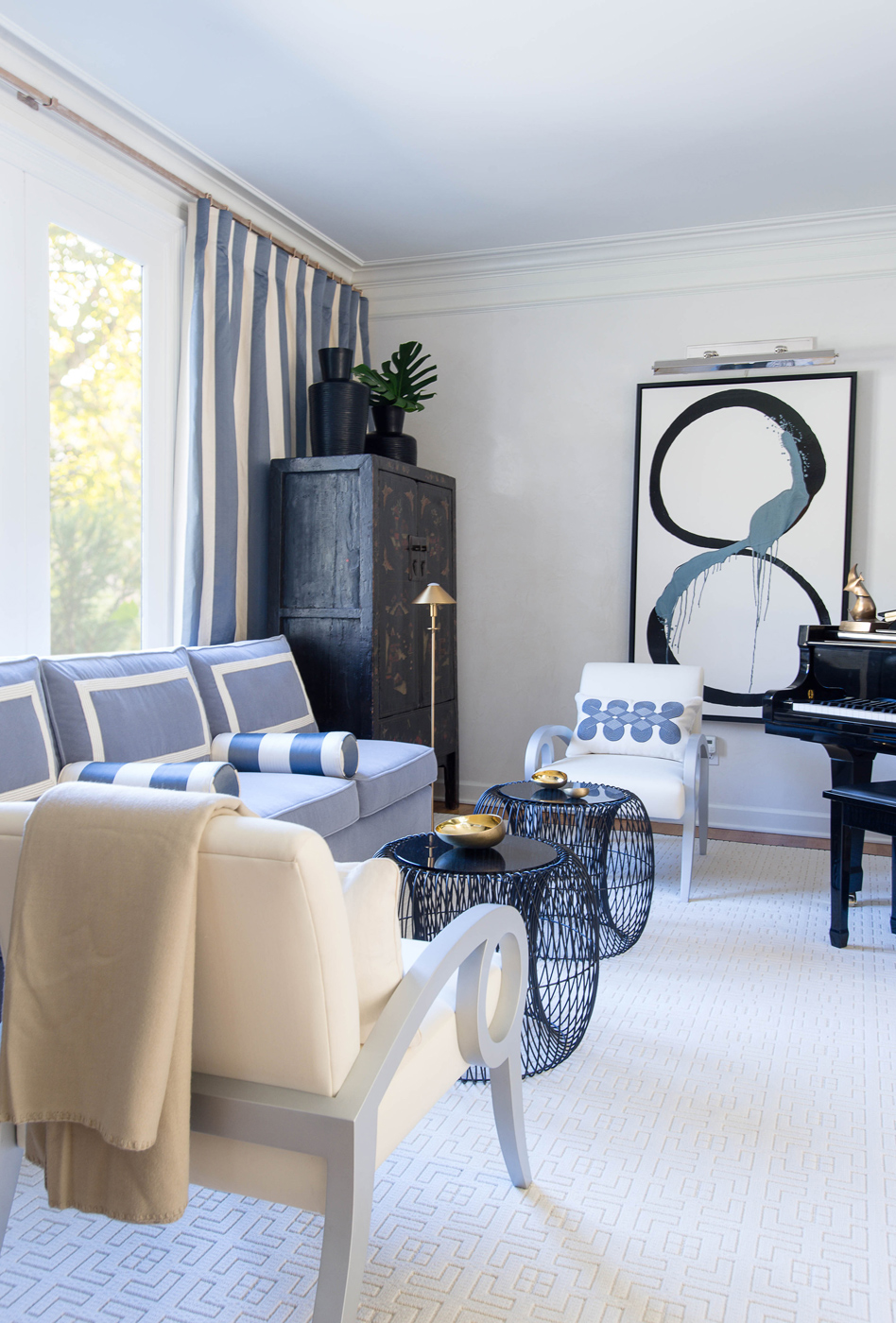 Music room featuring blue mohair sofa, Calvin Klein Home wire occasional tables, and Kayce Hughes painting | Savage Interior Design