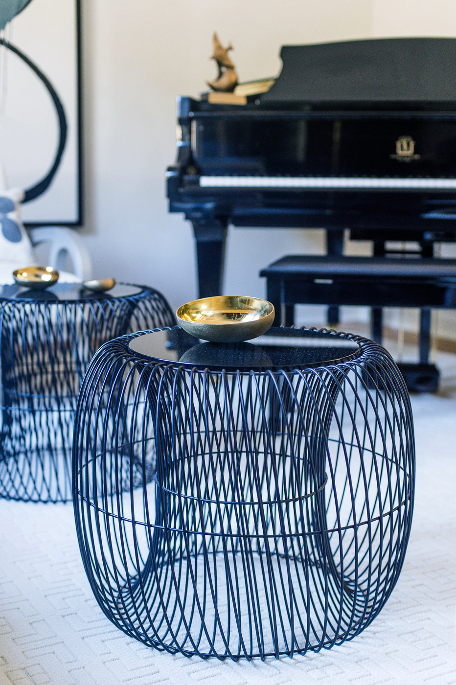 Music room detail of Calvin Klein Home wire occasional tables with smoky glass tops | Savage Interior Design
