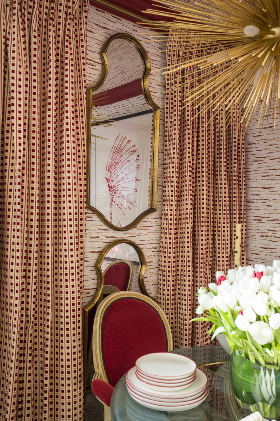 Dining room featuring red, white, and gold accents   Savage Interior Design
