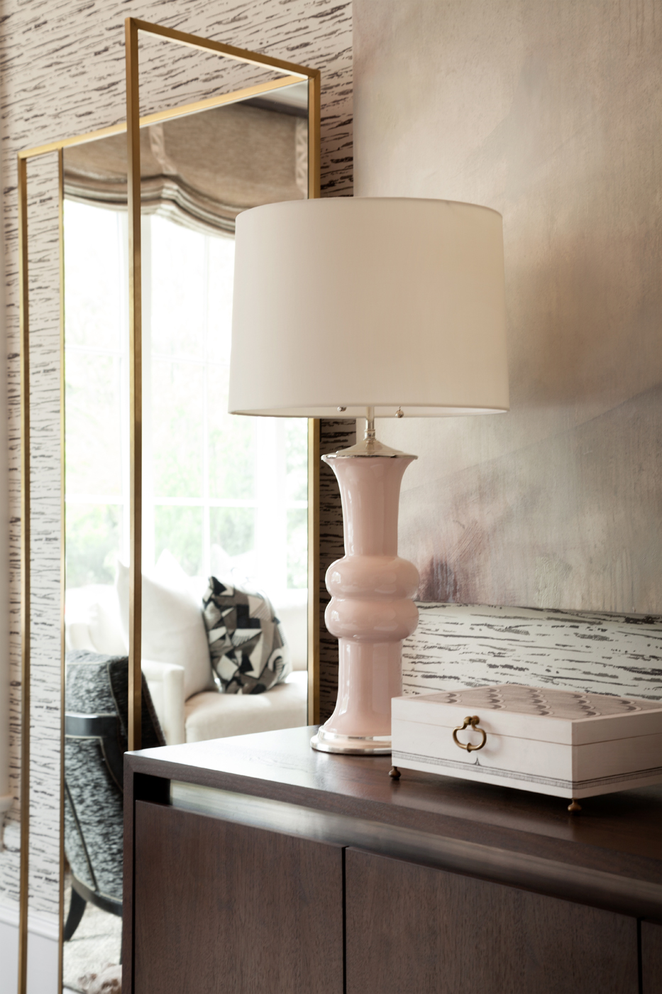 Modern pale pink table lamp on a cabinet with an abstract painting backdrop | Savage Interior Design