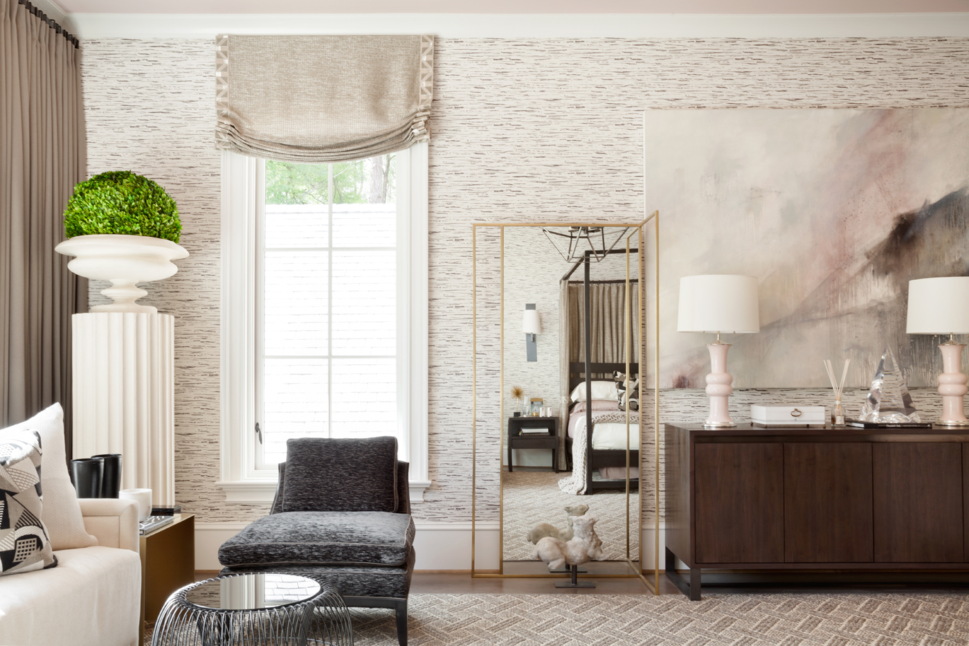 Green from an accent topiary pops from a neutral and pale pink palette in this Atlanta show house bedroom | Savage Interior Design