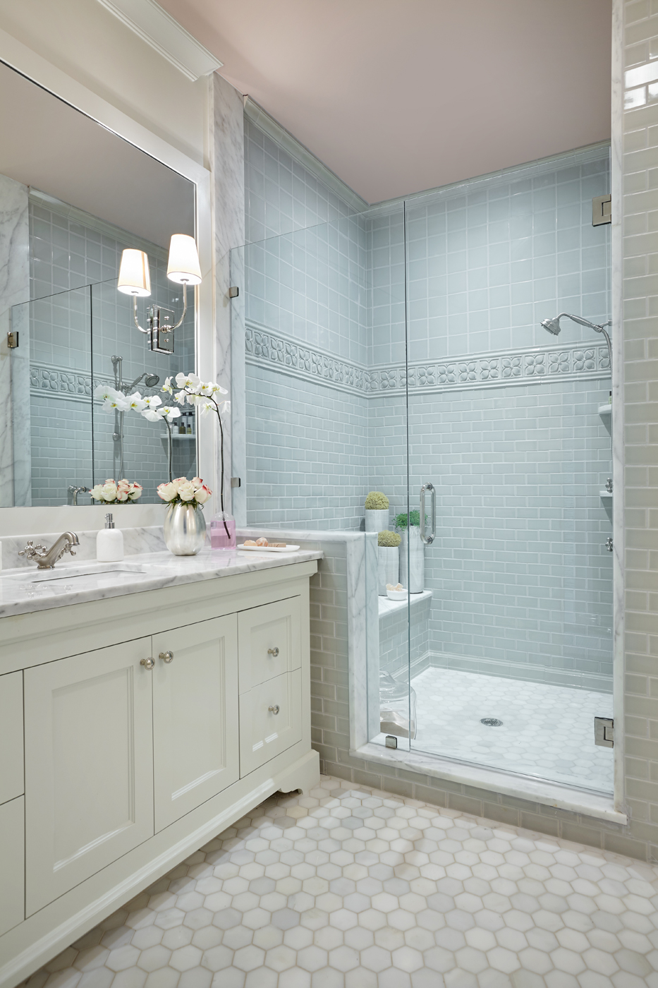 Pale pink ceiling paired with cool light blue tiles in this Atlanta show house bathroom | Savage Interior Design