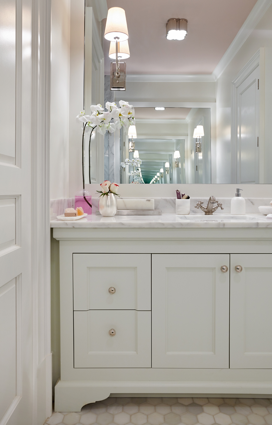 Clean-lined yet classic white bathroom vanity paired with pale pink ceiling color in this Atlanta show house | Savage Interior Design