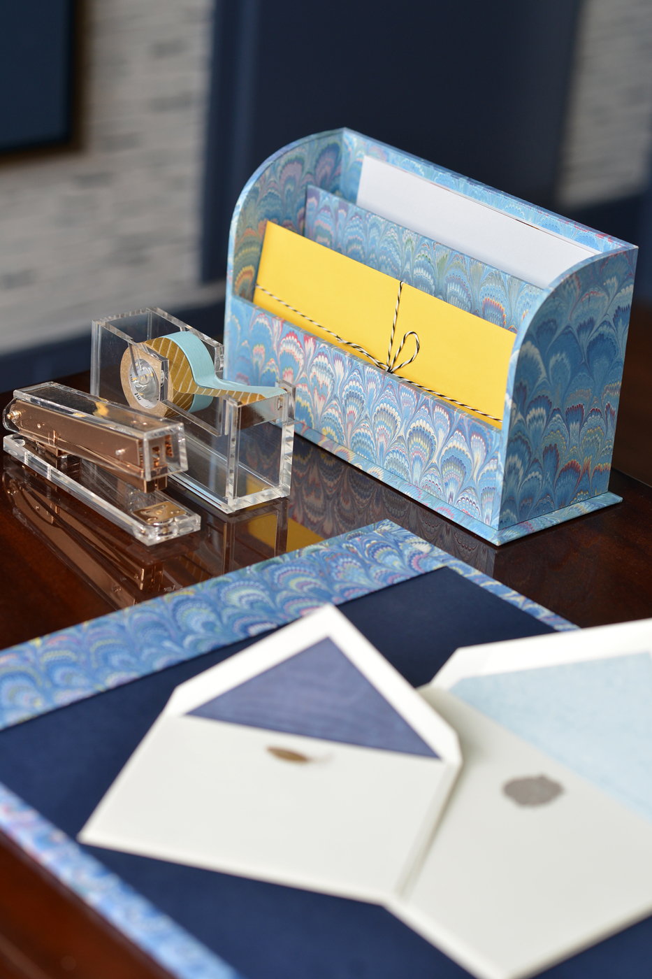 Decorating with acrylic lucite desk accessories and blue marbled paper in a home office | Savage Interior Design