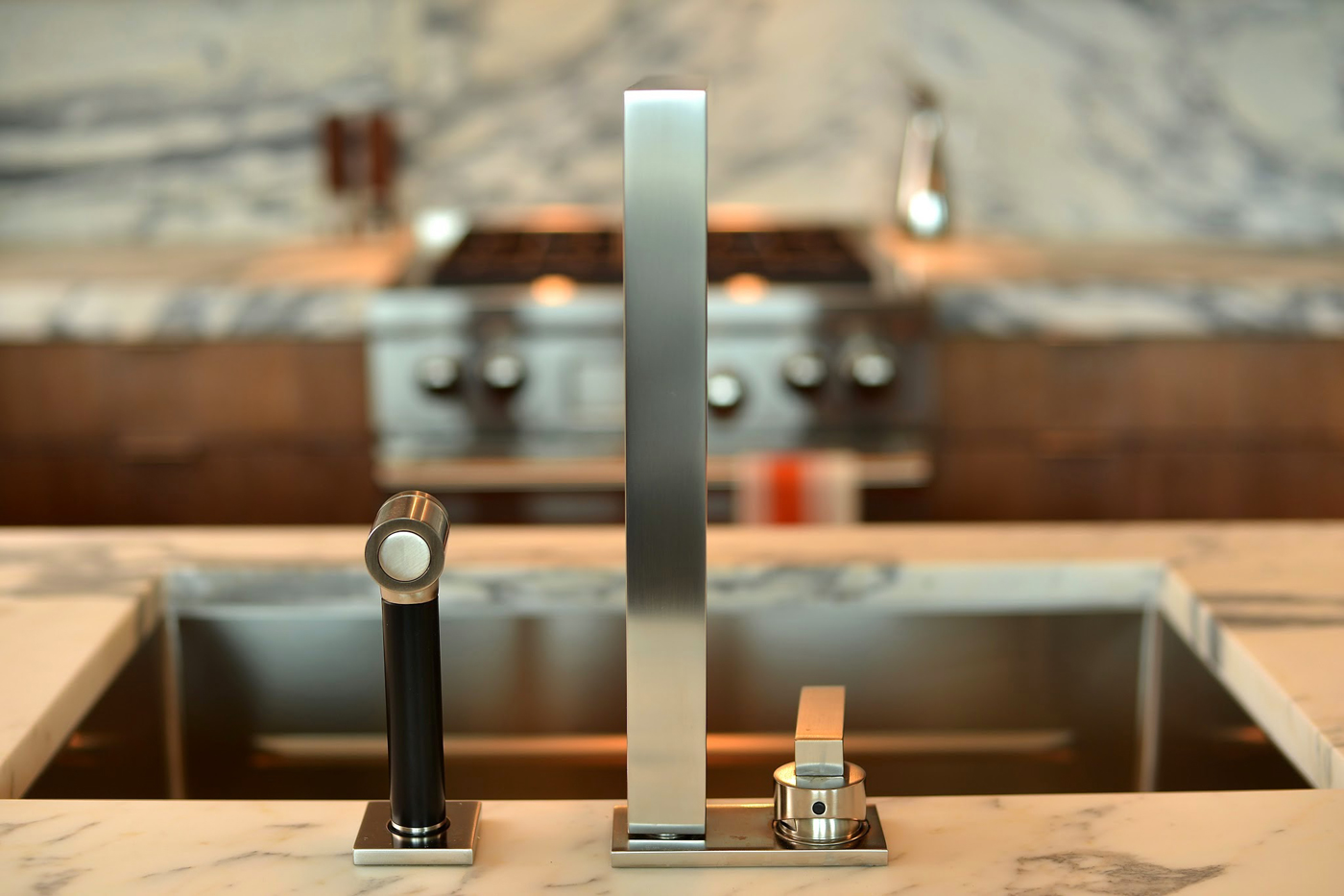 Sleek modern steel finish kitchen faucet detail | Savage Interior Design
