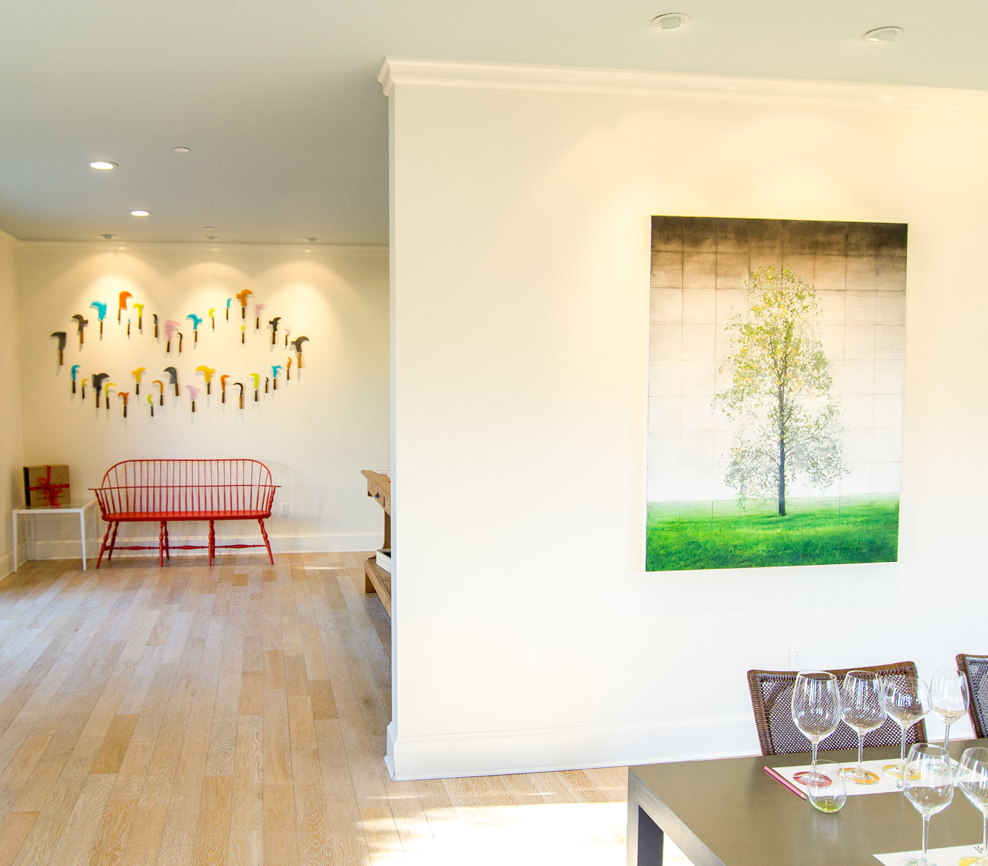Colorful artwork adorns the walls of the tasting house at VGS Chateau Potelle | Savage Interior Design