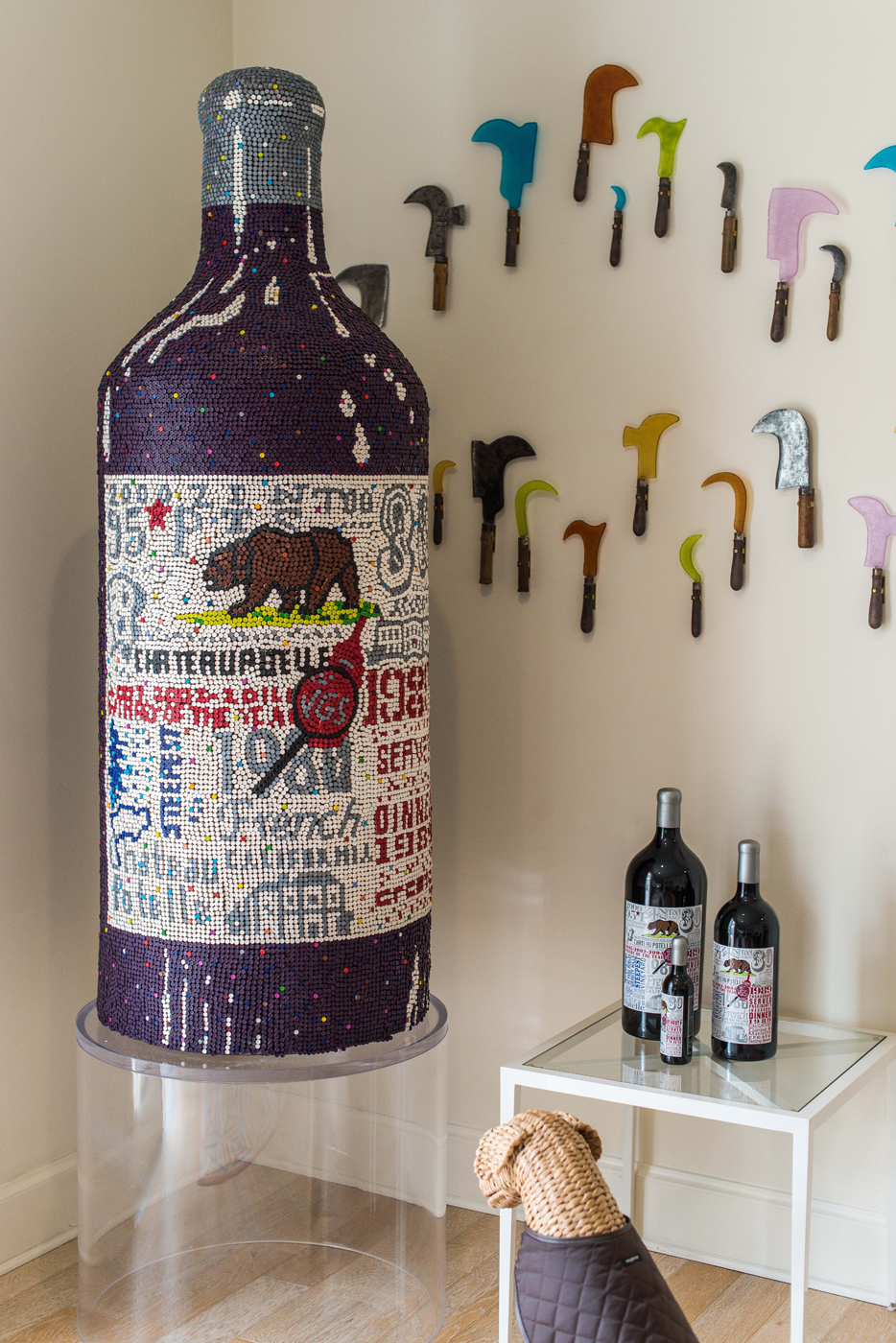Artwork shown is an oversized wine bottle made of crayons by a Nashville artist | Savage Interior Design