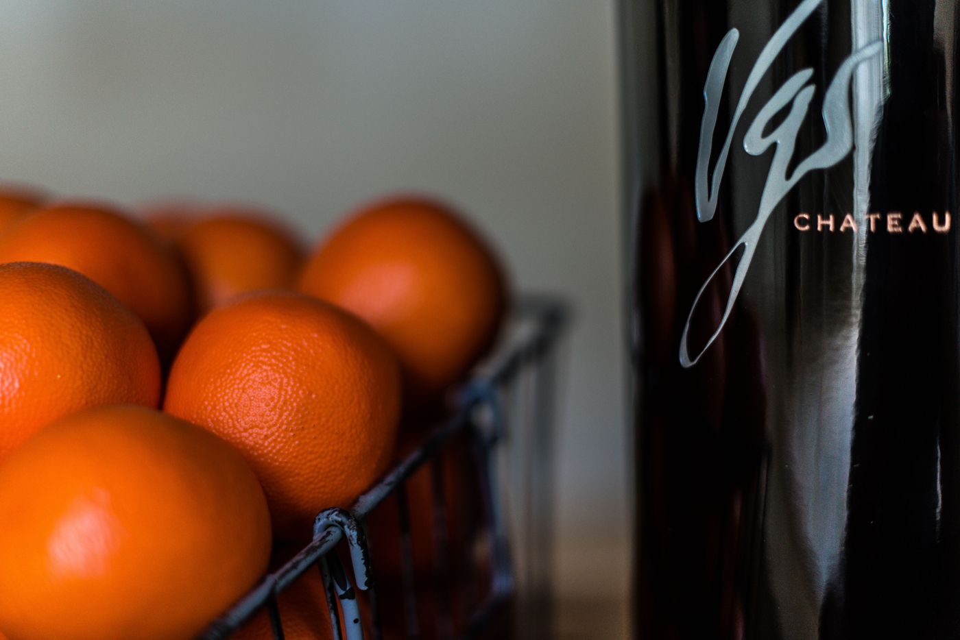 Oranges on display with a VGS Chateau Potelle wine bottle in their tasting house | Savage Interior Design