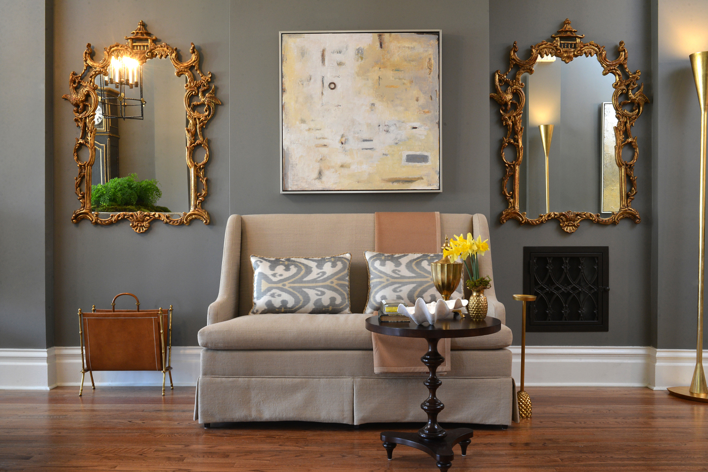 Settee flanked by gold Georgian style chinoiserie mirrors and painting by Nashville artist Ed Nash | Savage Interior Design