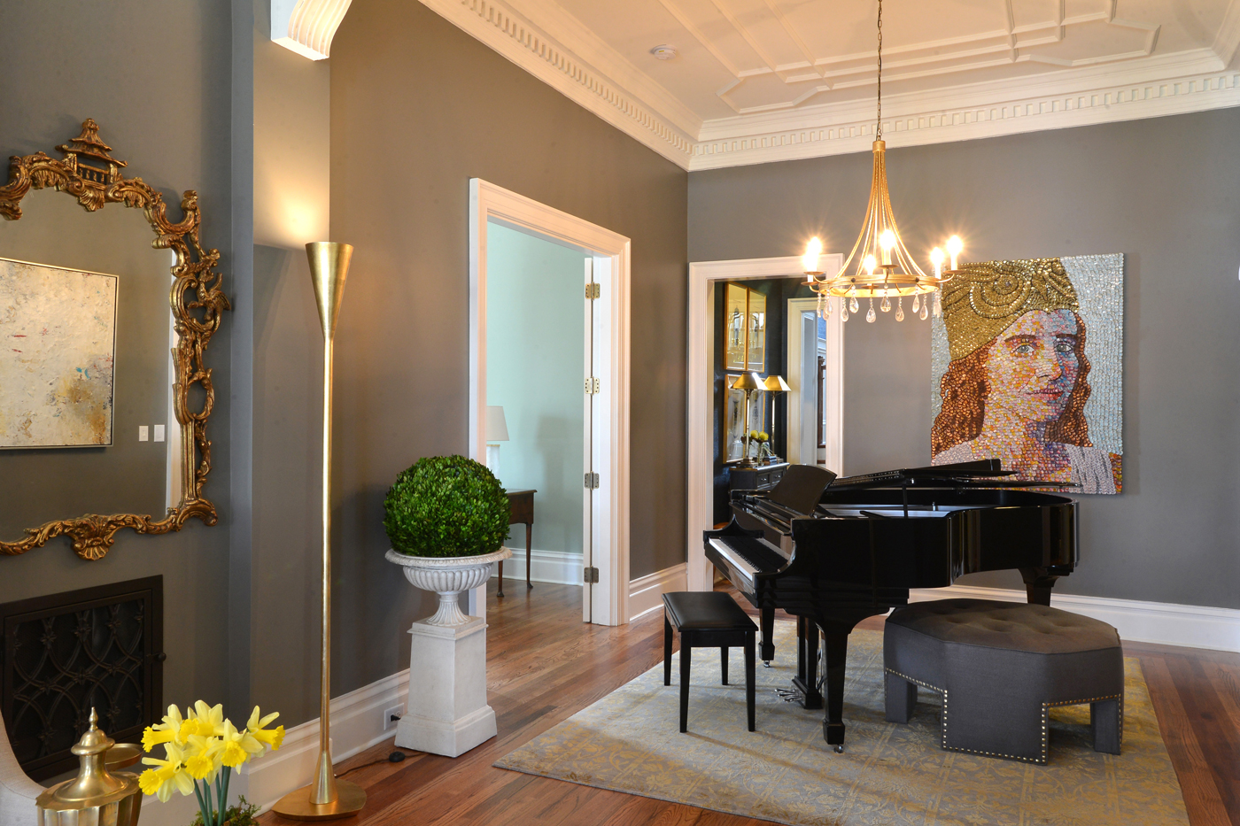 Custom ceiling tracery above piano and large ottoman anchoring the rear of the entry room | Savage Interior Design