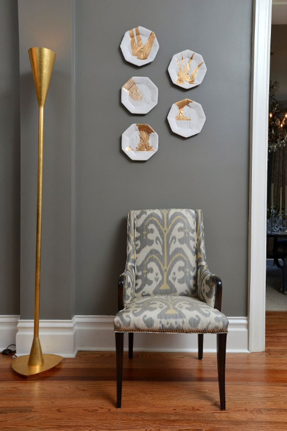 Upholstered chair and torchiere grouped with hand cast plates designed by artist Jedediah Morfit | Savage Interior Design