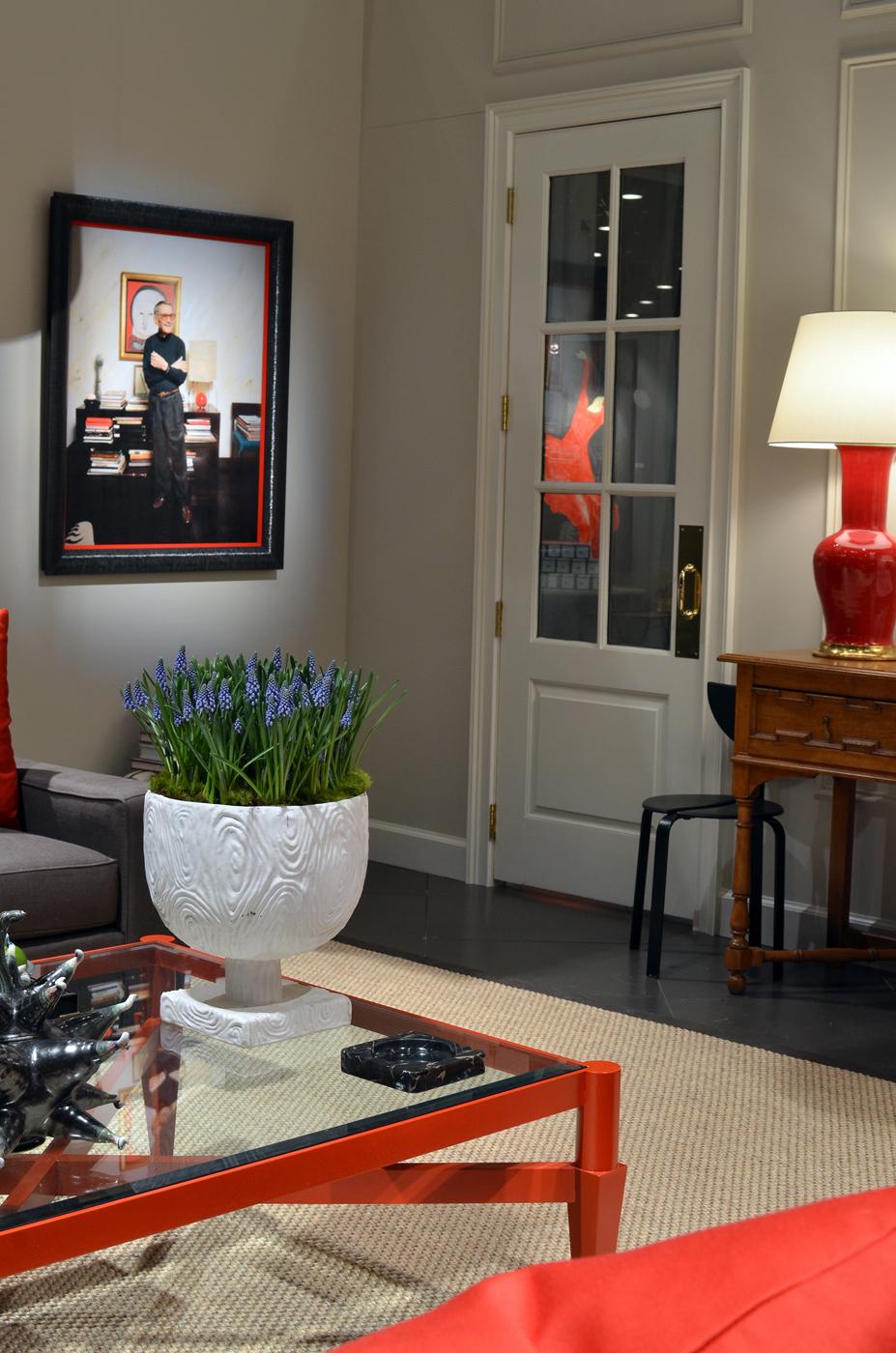 Photo of Albert Hadley on wall of living room installation | Savage Interior Design