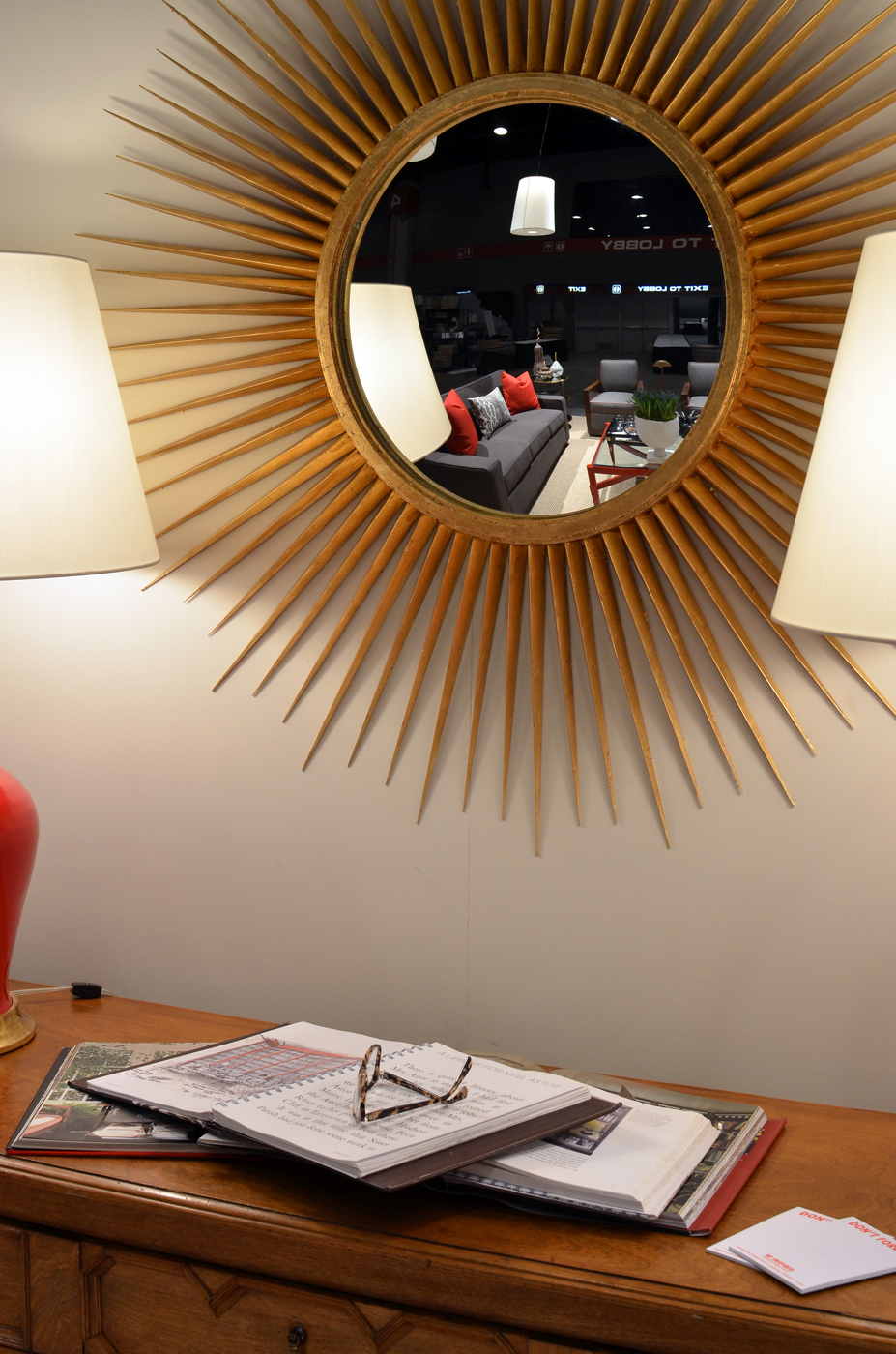 Gold sunburst decorative mirror over antique console table | Savage Interior Design