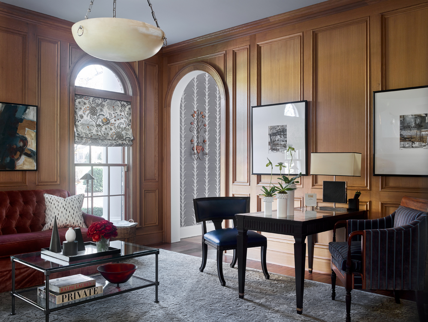 Library paneled in quarter-sawn white oak; Hickory Chair Marler sofa, table, and chairs | Savage Interior Design