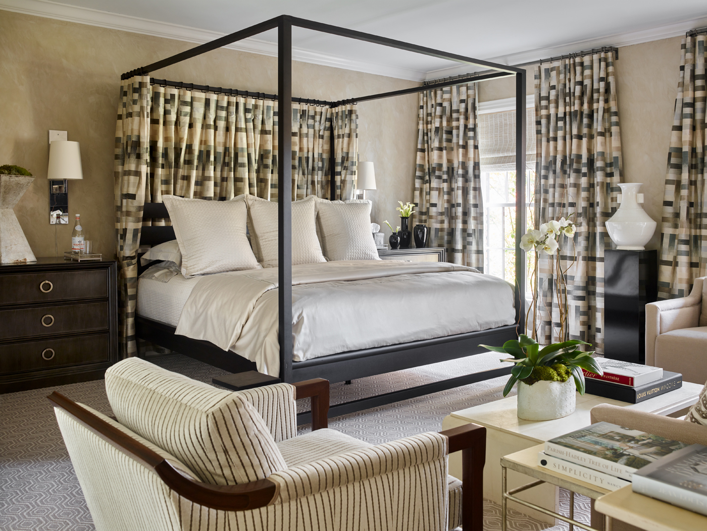 Bedroom with Calvin Klein Home canopy bed draped in Fantasque Bakst from Osborne & Little; Christian Liaigre sconces | Savage Interior Design