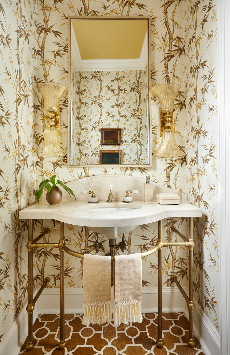 Powder room marble vanity top with brass legs; bamboo print wallcovering; art glass sconces | Savage Interior Design