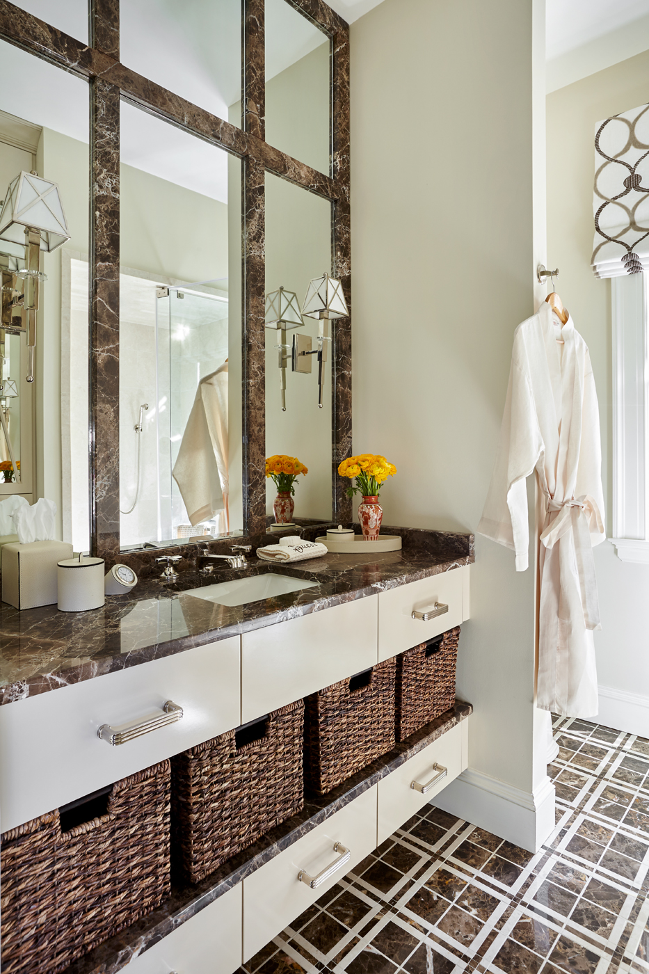 Bathroom vanity with baskets on shelf; Emperador Dark and Crema Marfil marble | Savage Interior Design