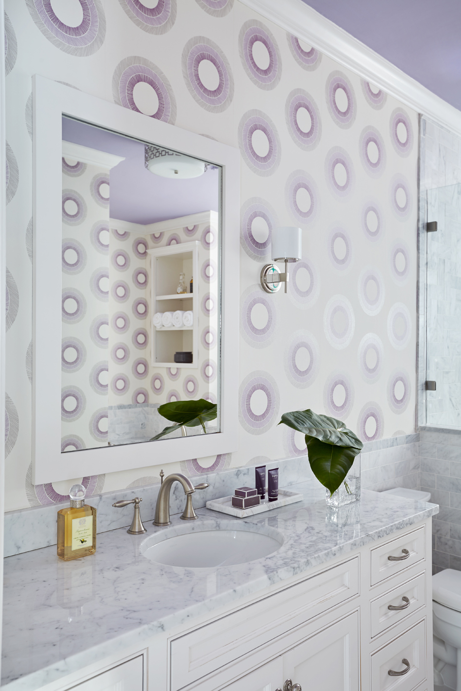 Bathroom wallpaper with lavender concentric circles on ivory field in Osborne & Little Parure pattern | Savage Interior Design