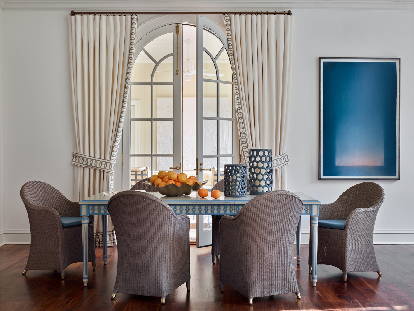Breakfast area with Janus et Cie chairs, Palladian style French doors, linen curtains | Savage Interior Design