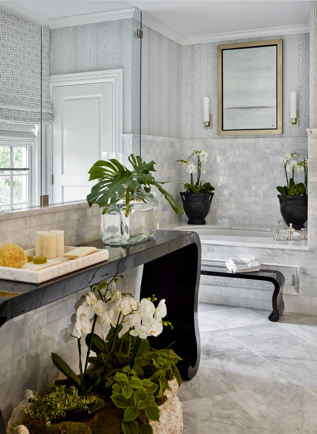 Bathroom in white marble with black waterfall table by Ballard Designs; giant clamshell planter | Savage Interior Design