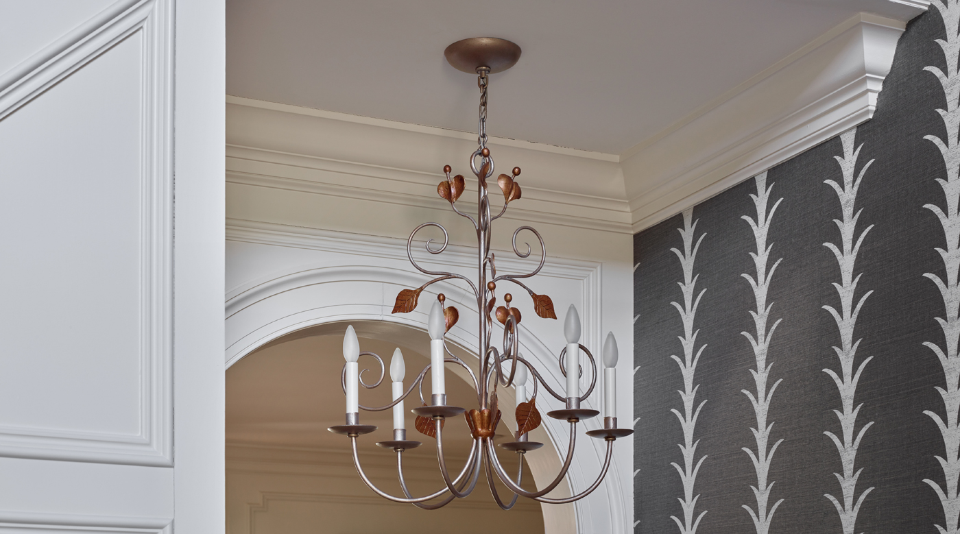 Metal chandelier with copper leaves and tendrils; Schumacher Acanthus Stripe wallpaper; paneling | Savage Interior Design