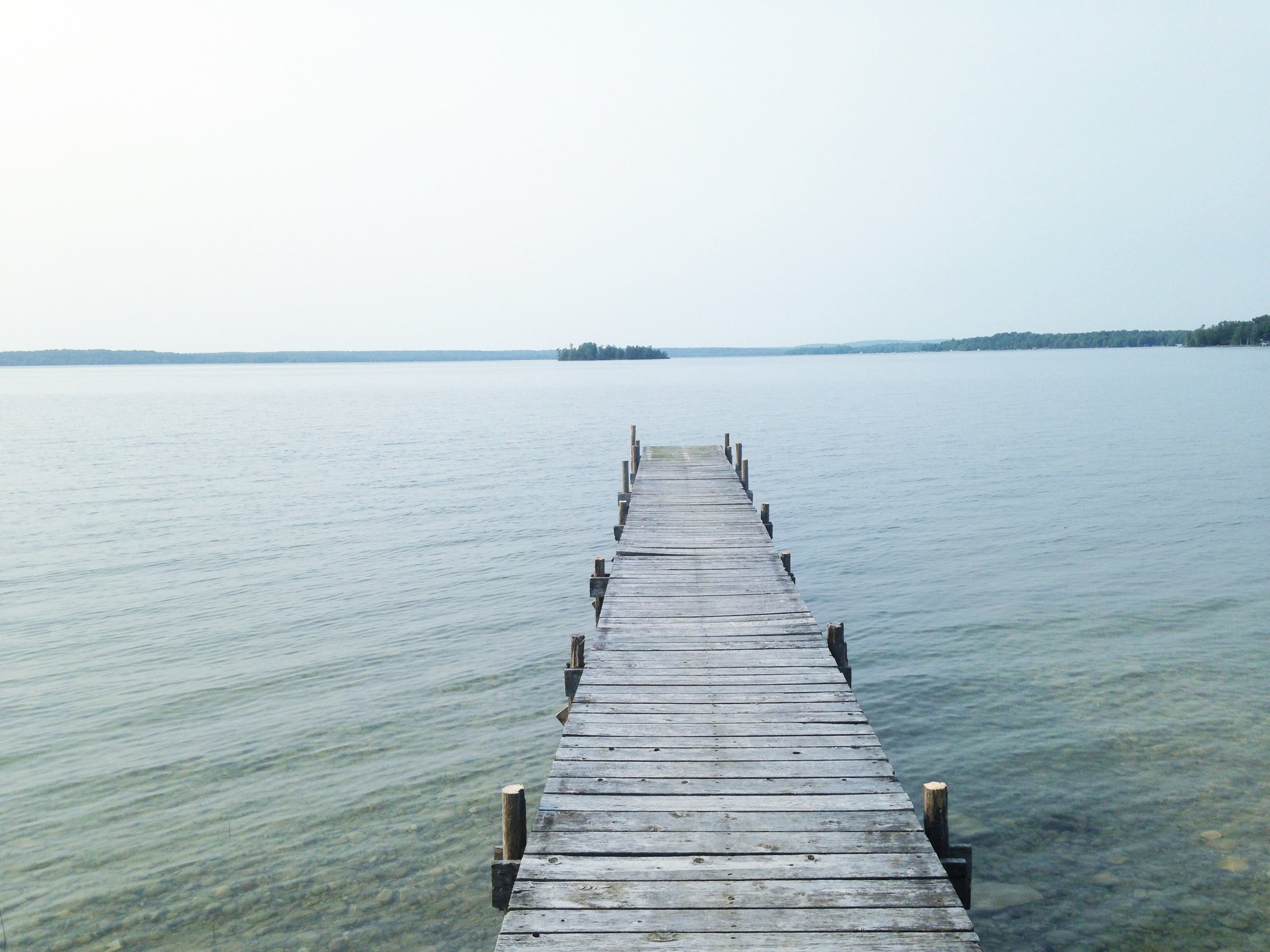 Our intern, Suzanna captured this moody dock on the north shores of Michigan. #AllTheHeartEyes