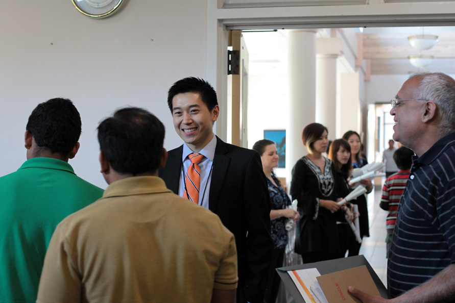 John Chen, Educational Consultant from ILUMIN Education, speaking with seminar attendees (and new friends).