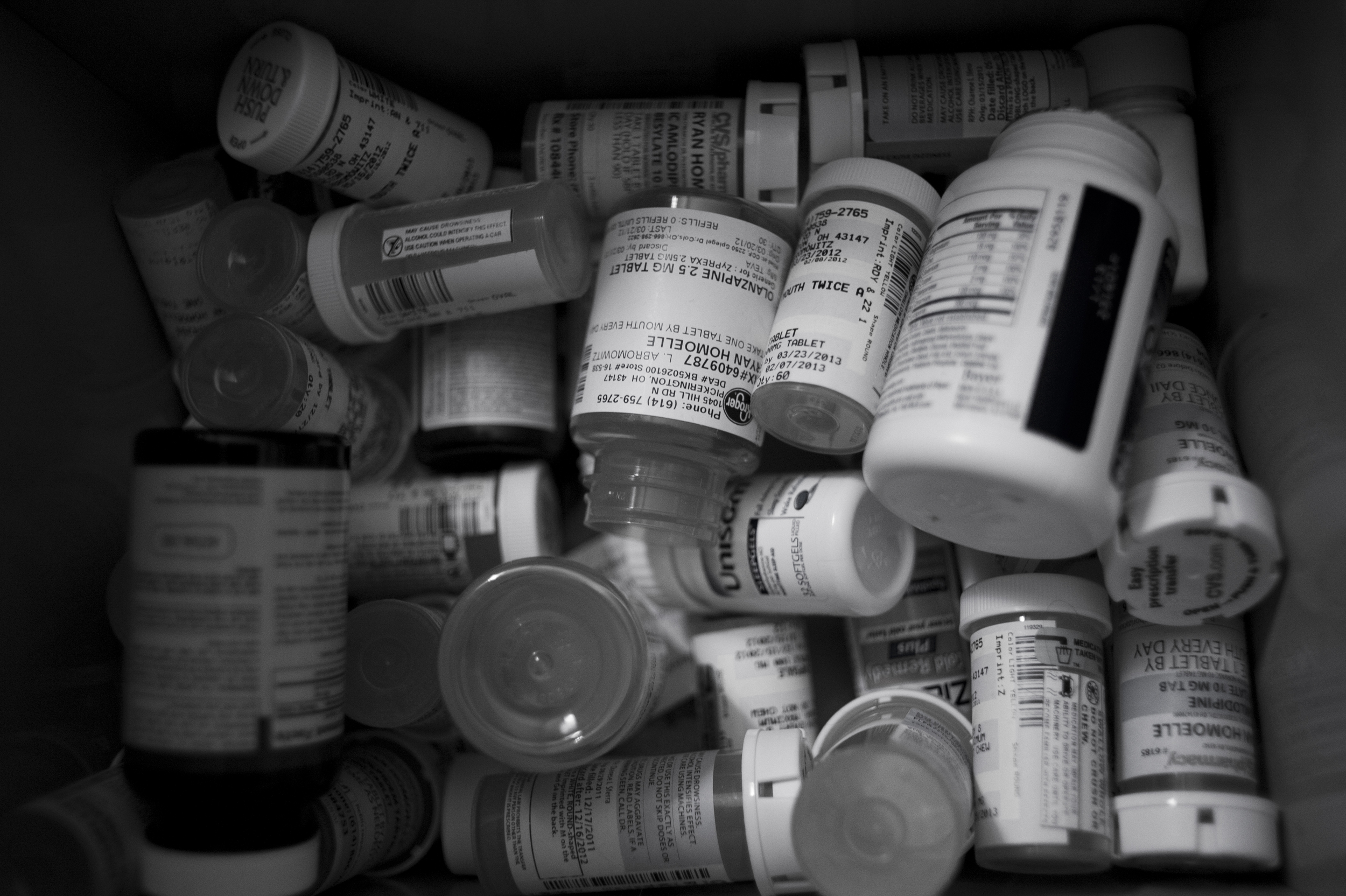 """A graveyard of medications and empty bottles fill a small box Ryan keeps under his bed. Misdiagnosed as bipolar and prescribed Lithium at a young age, Ryan has developed serious dependency to several of the medications doctors prescribed him. """"The Lithium and other medications enlarged my heart, and because of that they had to prescribe me a bunch of heart medications too."""""""