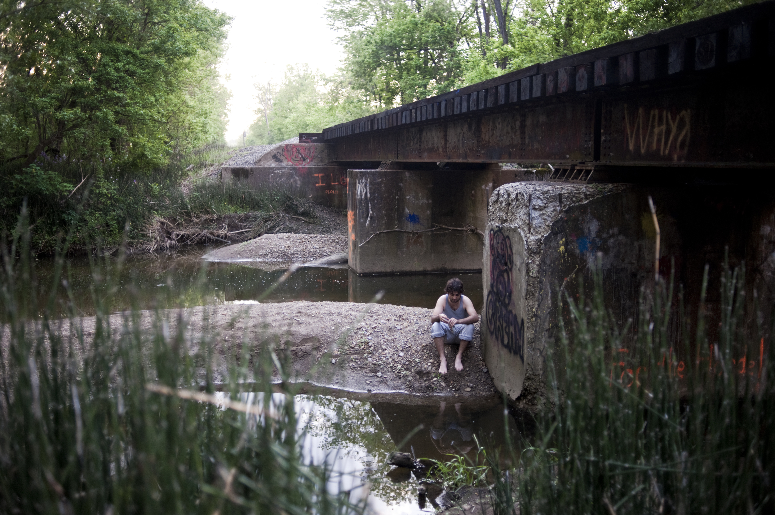 """""""I have my habits, and I have my problems, but as long as I'm alive I know that I'm alive for my family."""" Ryan sits by a bridge where he often collects his thoughts. """"Things are dark sometimes, so much so that you can't see any end to it, but if you keep going, there is a light."""""""