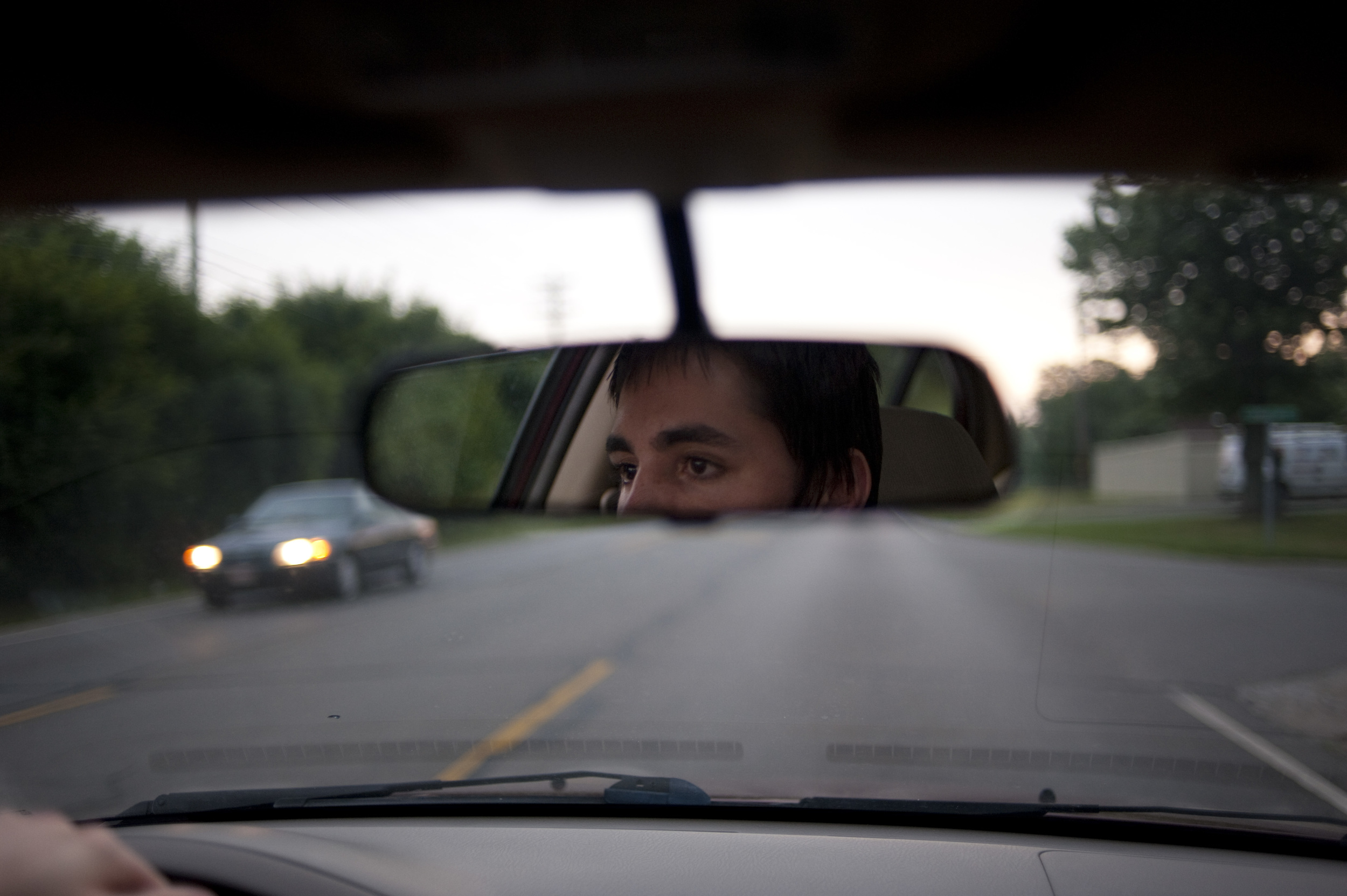 A user drives to a neighoring community to purchase a bag of black tar heroin.