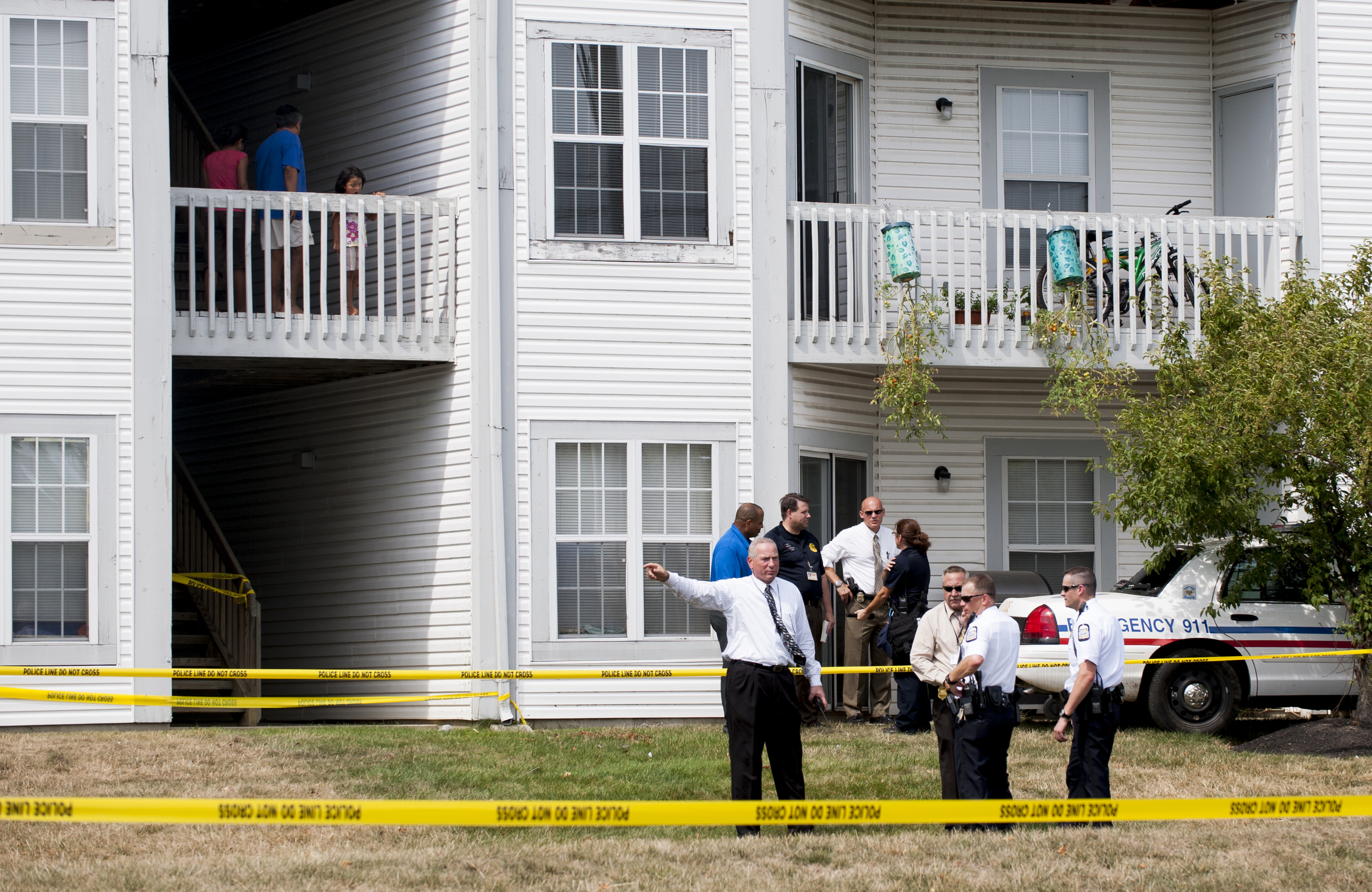 As the demand for heroin rises, and the availability of cheap housing units increases, drug operations that were once exclusive to the inner city are beginning to spill out into the suburban communities. Here, police officers investigate the scene of a home invasion and shootout. As drug dealers expand operations into these formerly untapped markets, competition can erupt into violence as this shootout did in which two people were killed.