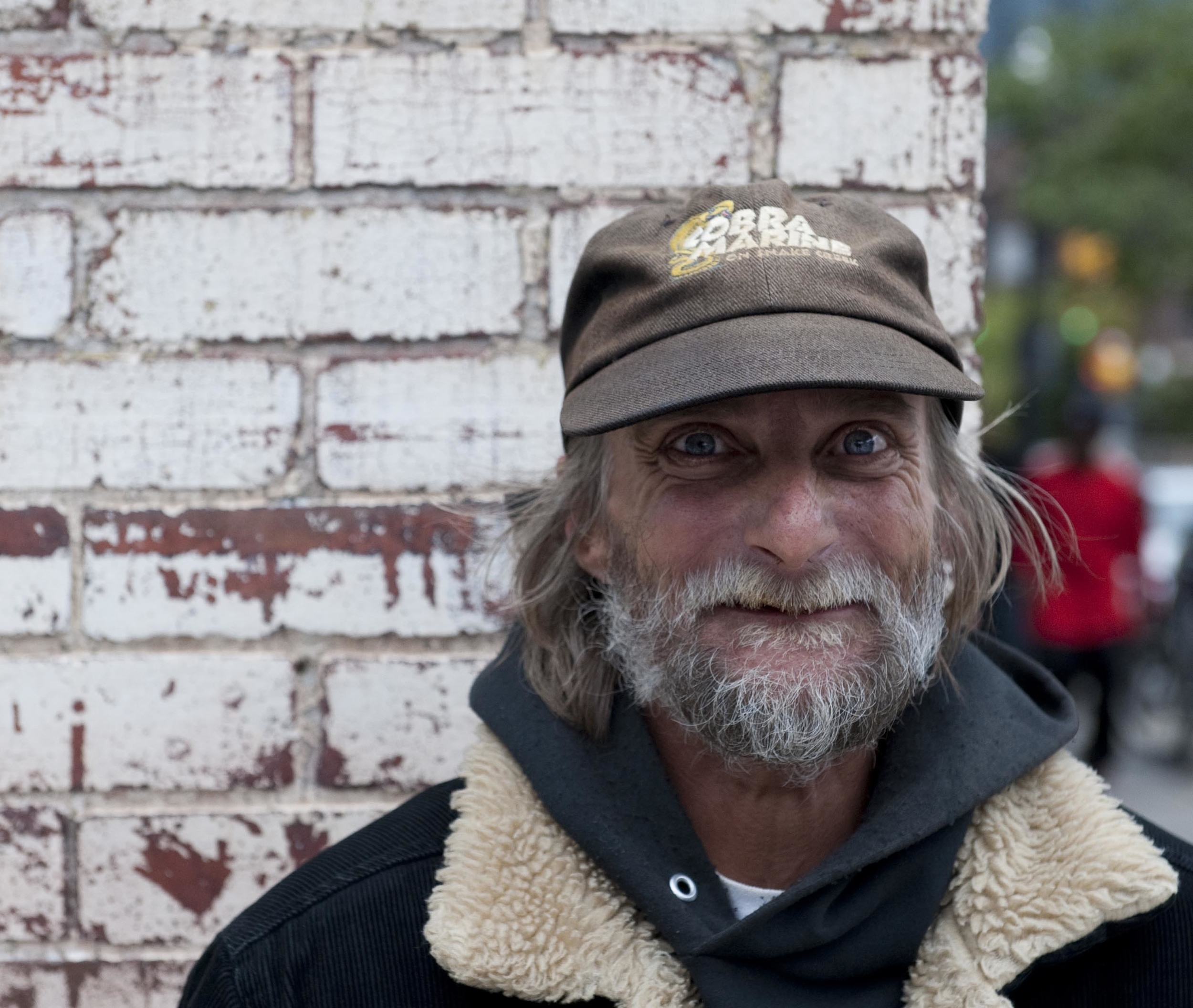 "Kenny Reed poses for a portrait on the Short North. ""Surviving isn't hard, it gets cold, you get hungry, you get sick, but these are things that you can fix here. There are people to help you out,"" he comments."
