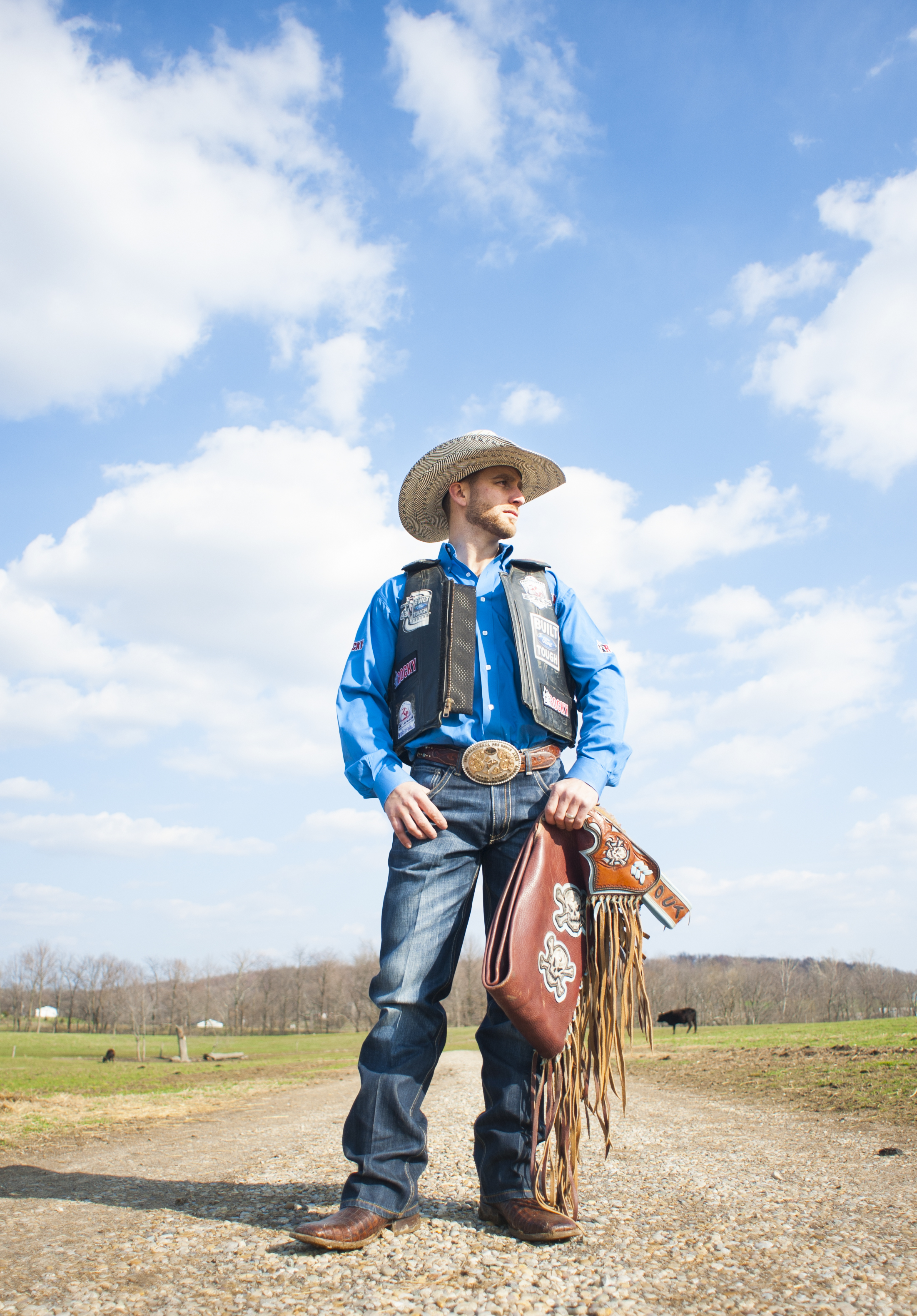 Shane Rickly of Stoutsville, Ohio poses for a portrait on his family's cattle farm in Amanda, Ohio. Rickly, a professional bull rider, recently was sponsored by Rocky Footwear after modeling boots for the company. Shane has lost a thumb and sustained various other injuries while riding, which he began at the age of 4.