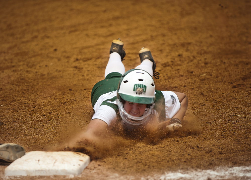 Freshman infielder Jenna Giusti dives for first at the end of the 6th inning during the Ohio University women's softball game against Buffalo on April 25, 2011. The Bobcats won the game 5-3.