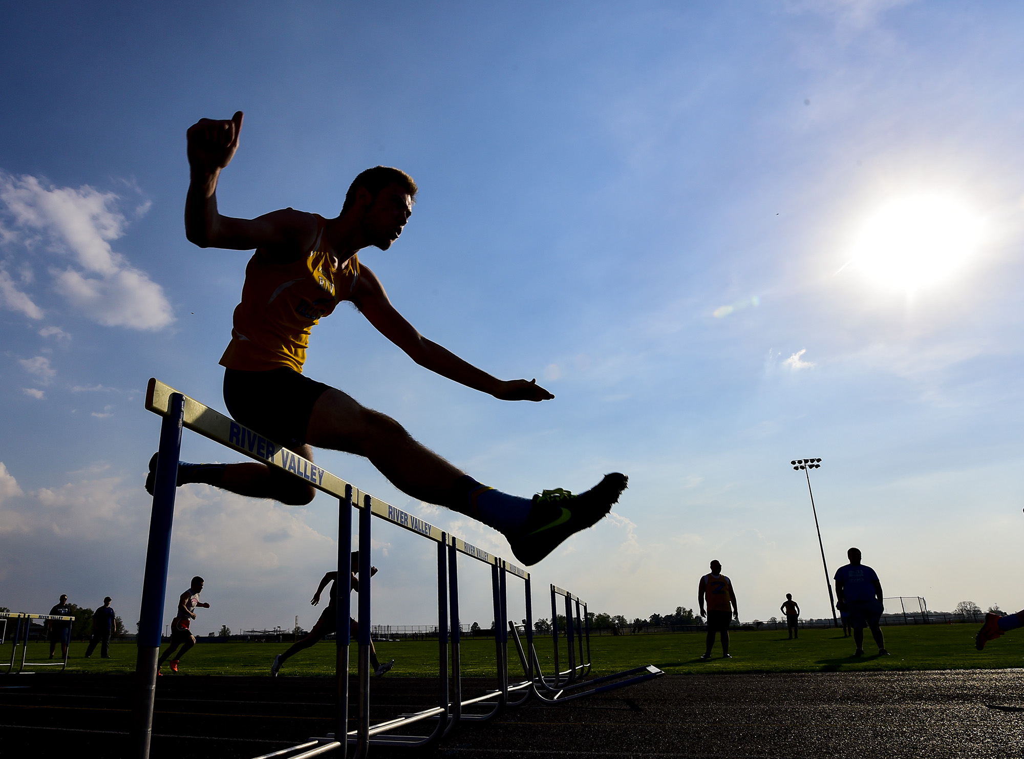 A hurdler bounds over a hurdle during the Marion County Track Meet hosted at River Valley high school on Wednesday, May 6