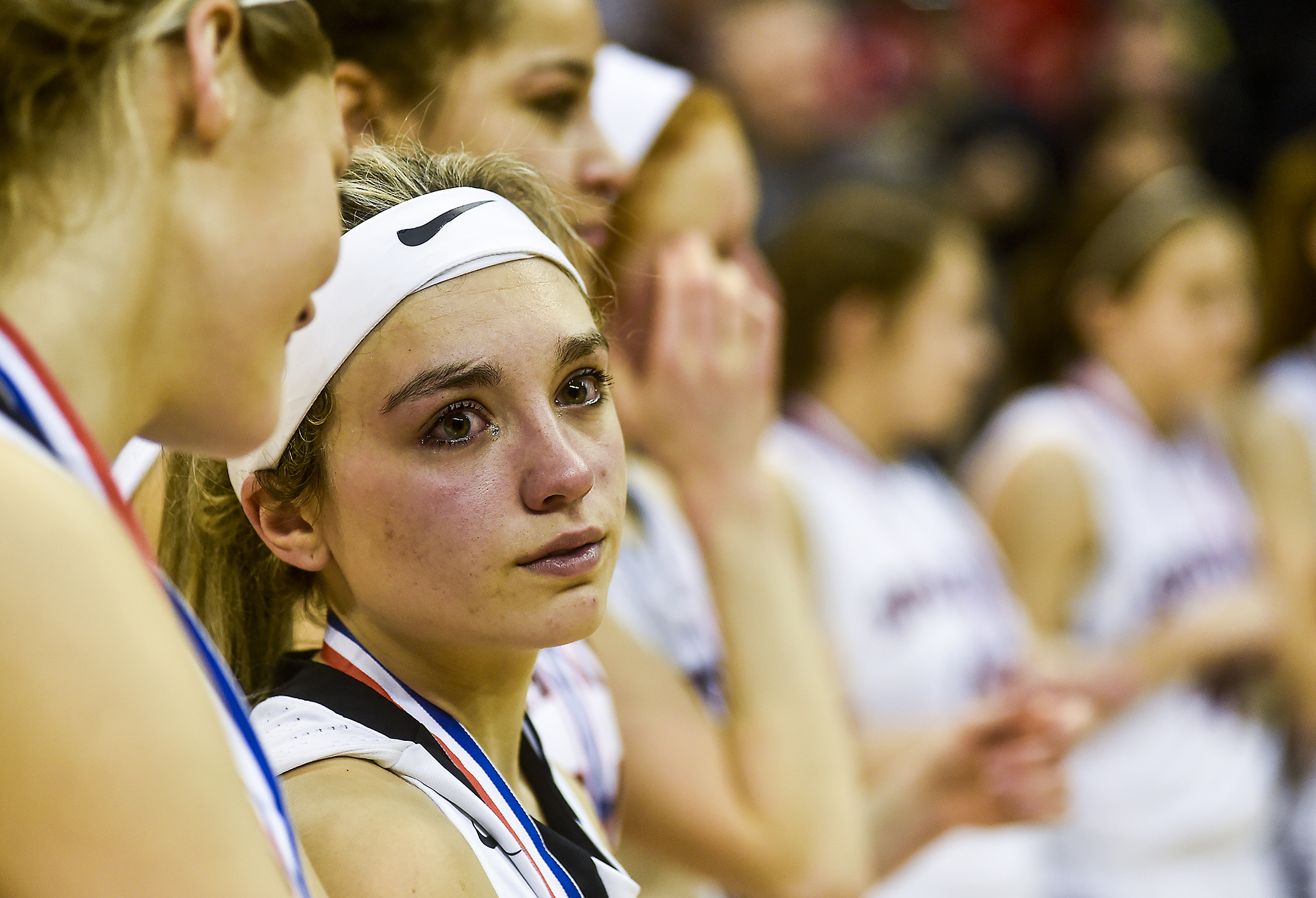 Tears run down Camryn Kimmel's face as she and the rest of her team, from Pleasant High School in Marion, Ohio, accept the second place trophy after falling to Africentric High School at the State Championship basketball game on Saturday, March 12 at the Schottenstein center in Columbus, Ohio. Camryn Kimmell and her teammates made up the first women's basketball team from Pleasant High School to make it to the championships.