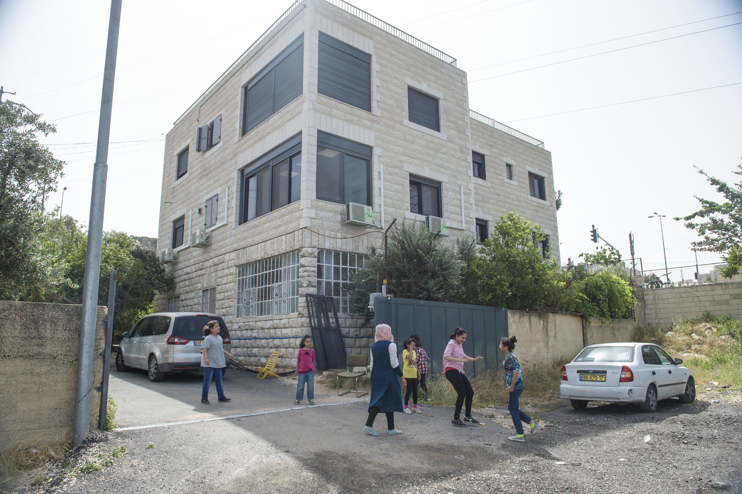 Students of the Peace Center for the Blind play outside of the school after preparation for their final exams. The school is located in the Shu'afat neighborhood of East Jerusalem and has served blind women for nearly 36 years as an education center and as a vocational school for those who wish to continue learning after they graduate.