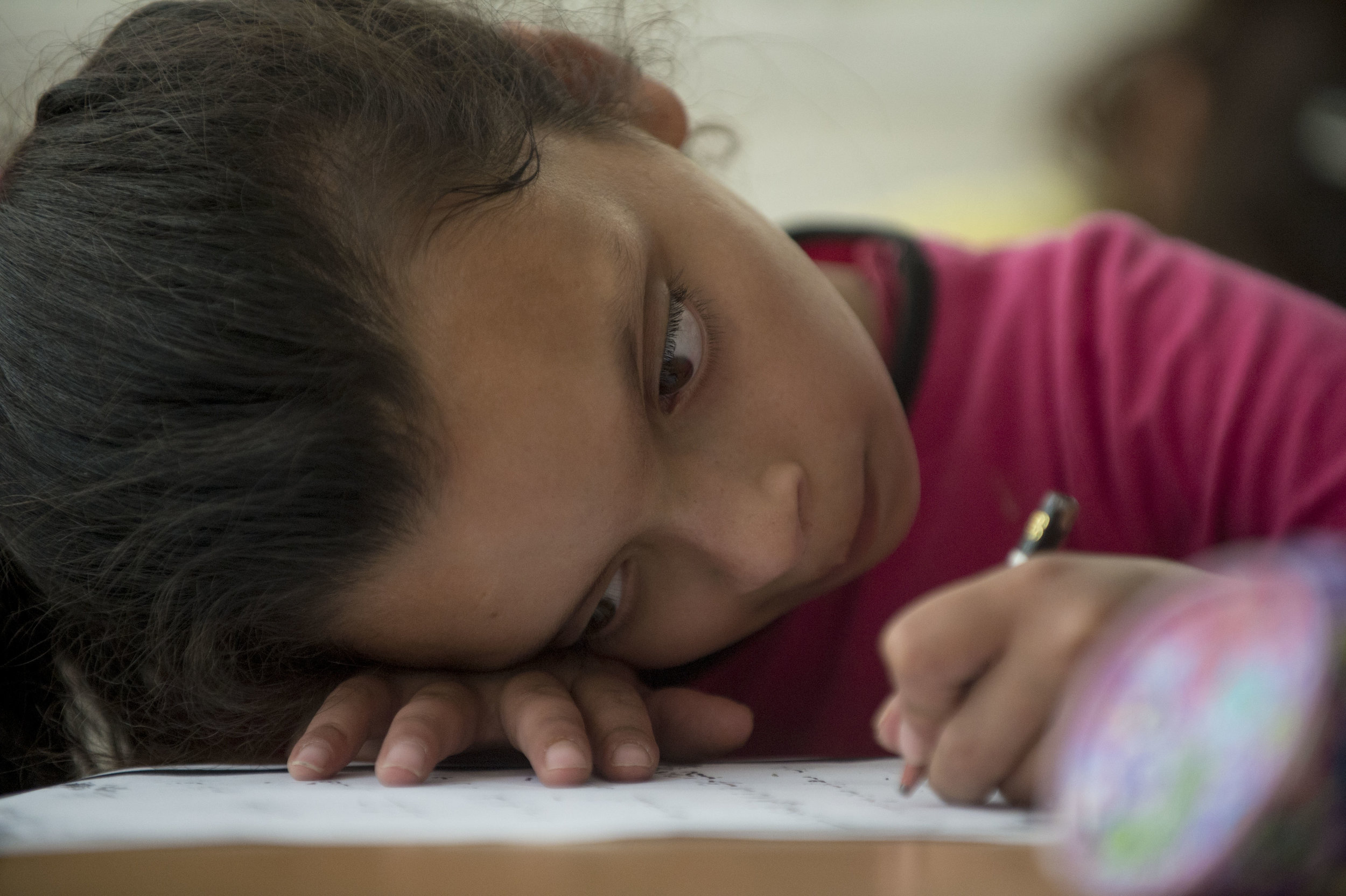 Ten-year-old Hala Kakaour concentrates on her exam work during classes at the Peace Center for the Blind in East Jerusalem. Hala still has partial vision however it is very limited like many of the other students at the school. In order to read and write Hala and others use bold pencils and must get extremely close to their work.