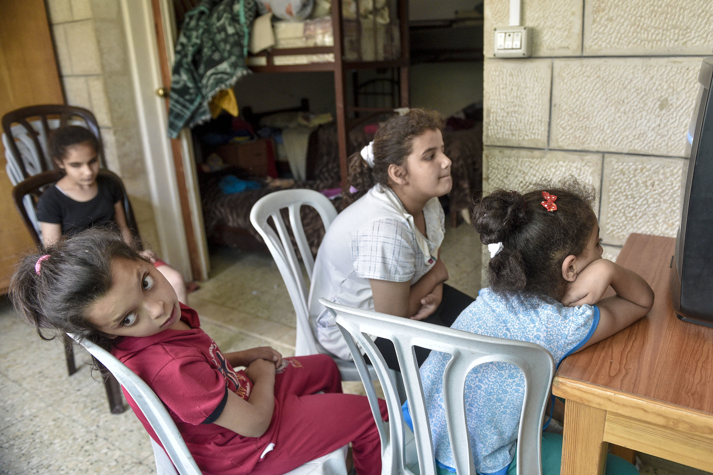The students of the Peace Center for the Blind listen to music on the television in the boarding house located in East Jerusalem shortly before they leave to go home for the summer. A school from Beit Hanina was supposed to stop by in the morning to meet the girls however never showed up.