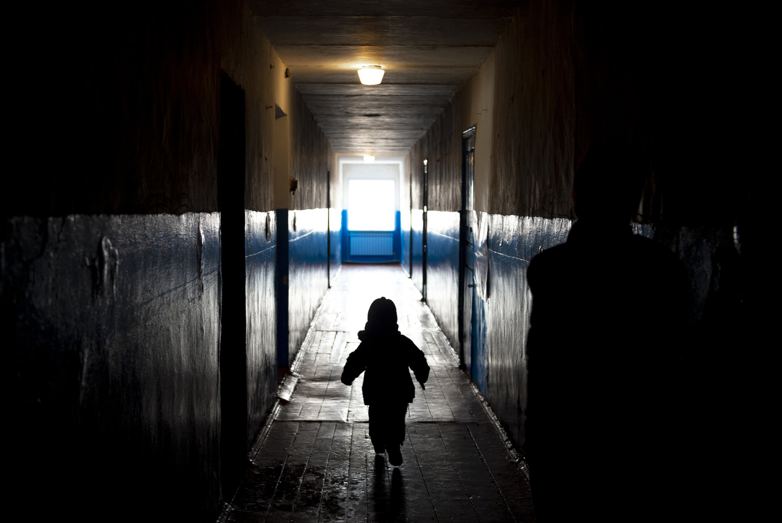 A young student bolts down the hall towards the exit of the elementary school in Krimsky.