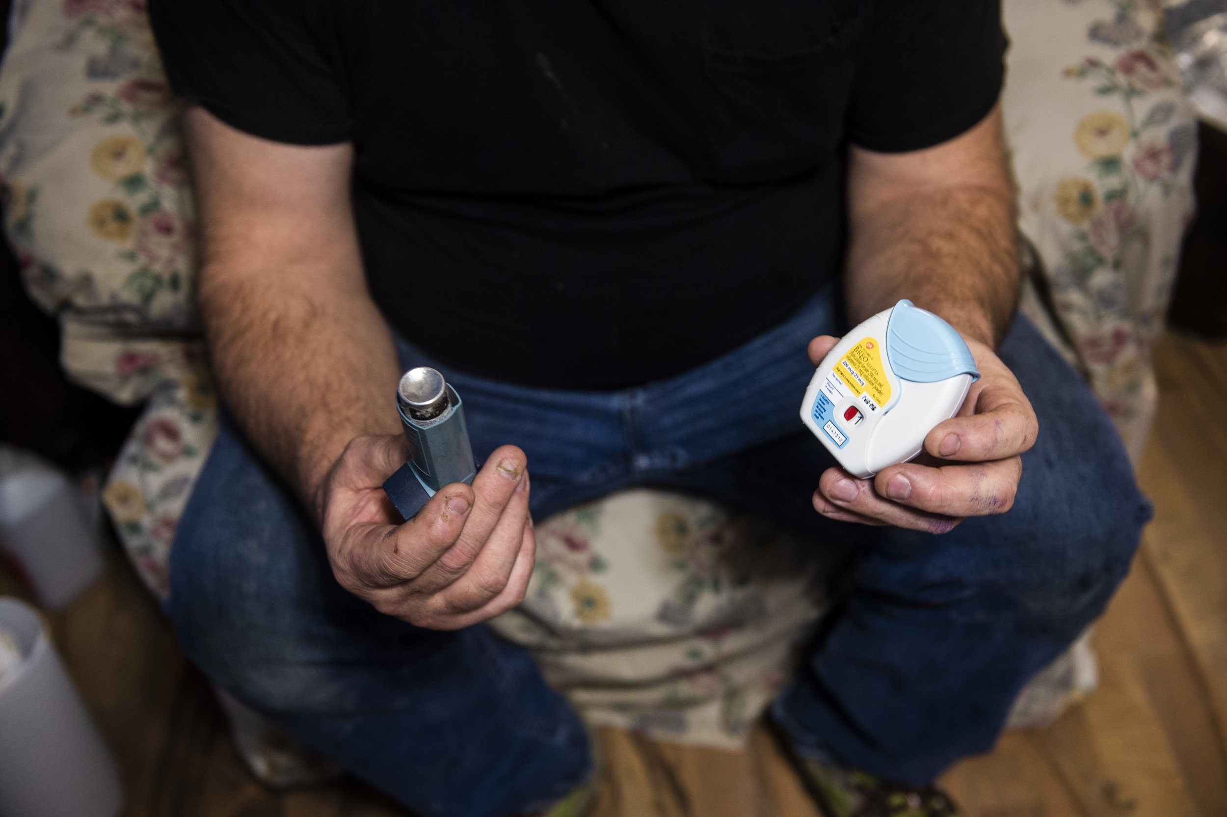 Harold Dotson shows the two inhalers he uses when he has breathing episodes due to his Black Lung Disease on Thursday, January 17 in Paw Paw, Kentucky.