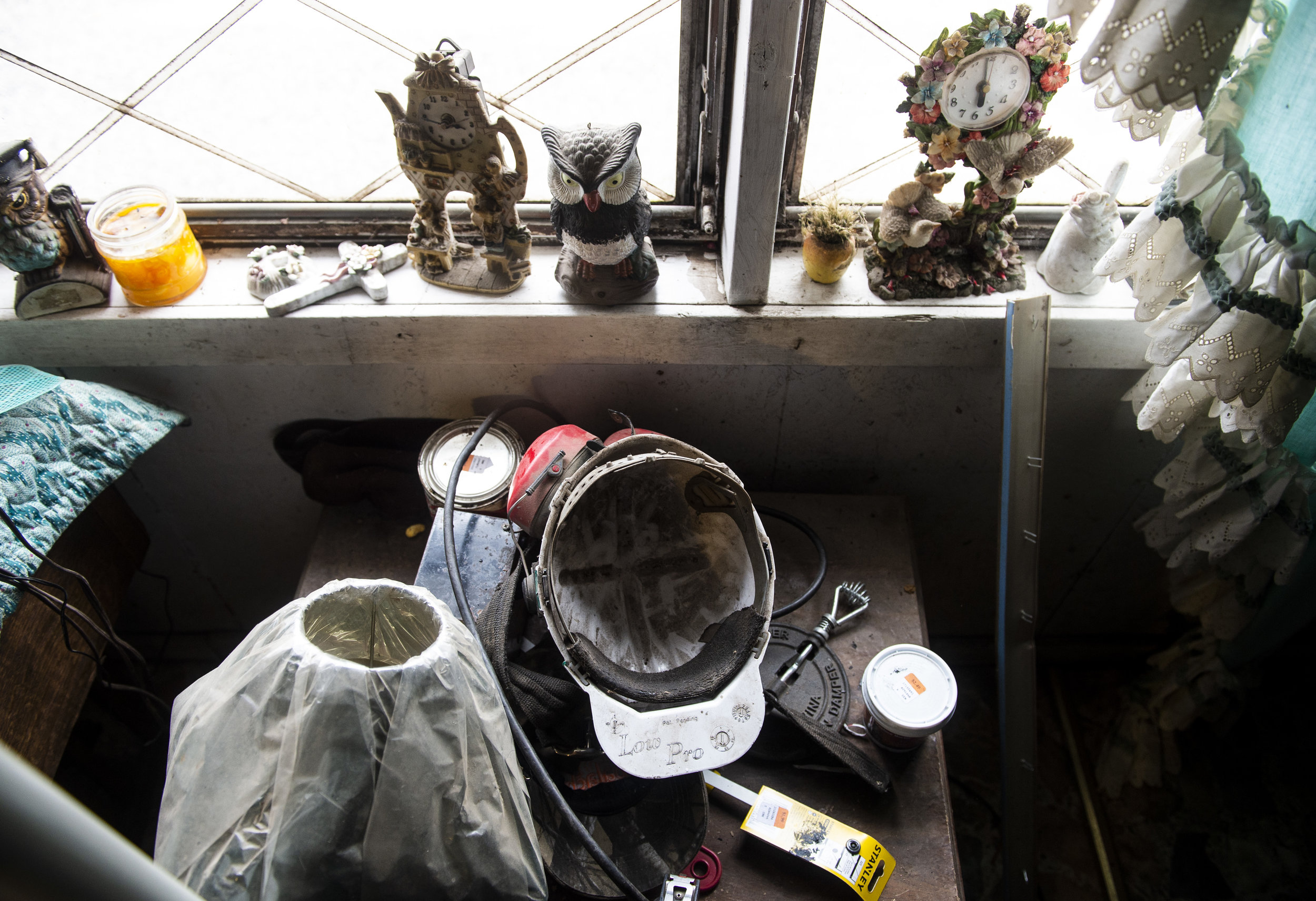 The coal miners helmet that Harold Dotson wore when he worked in the mines sits on a table near the front window of his home in Paw Paw, Kentucky on Thursday, January 17.