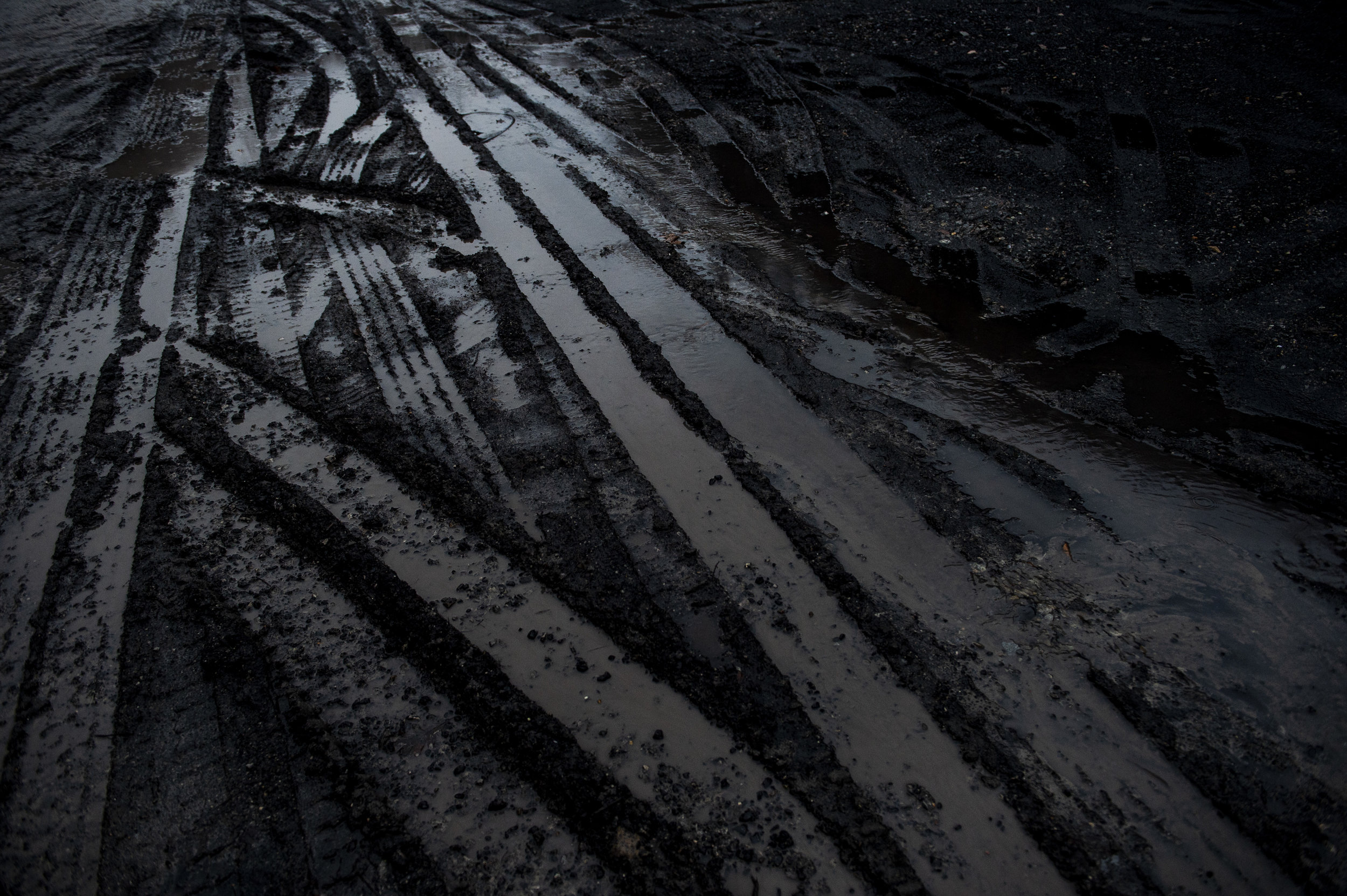 A parking lot covered in coal near a coal processing plant outside of Pikeville, Kentucky.